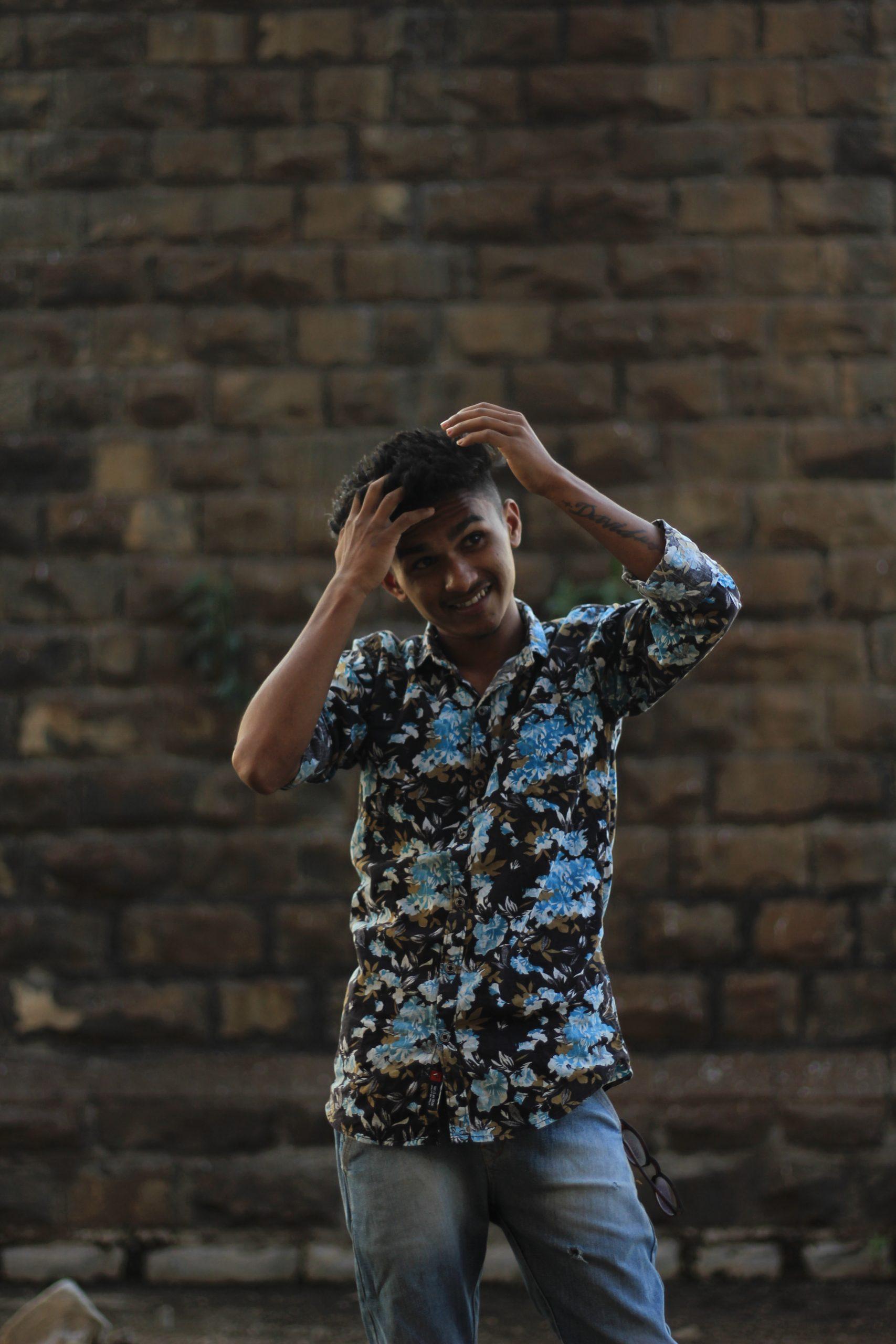 Boy posing hand on head