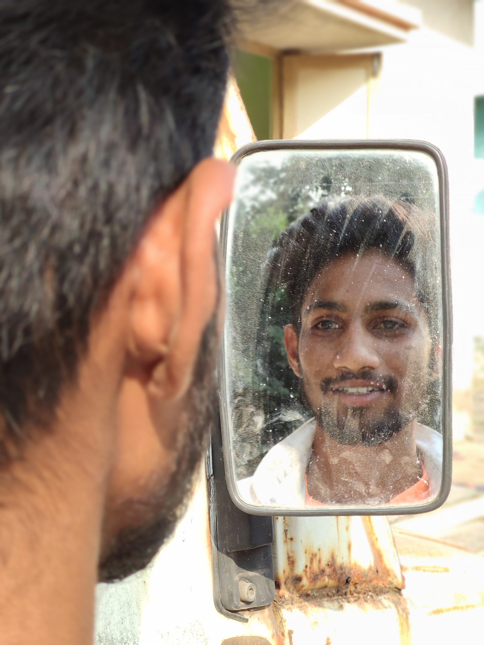 A boy watching mirror