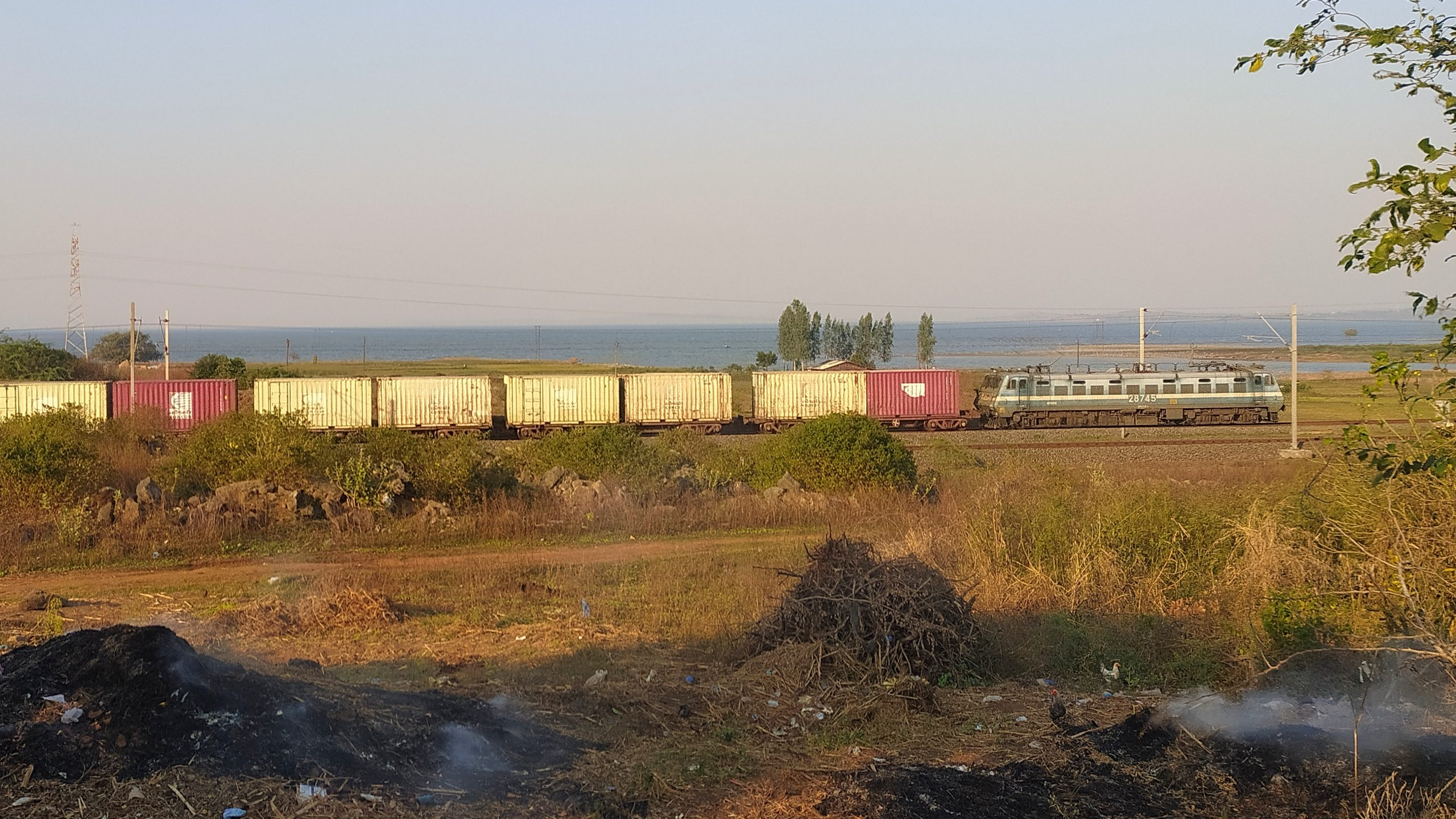 A goods train passing through a place