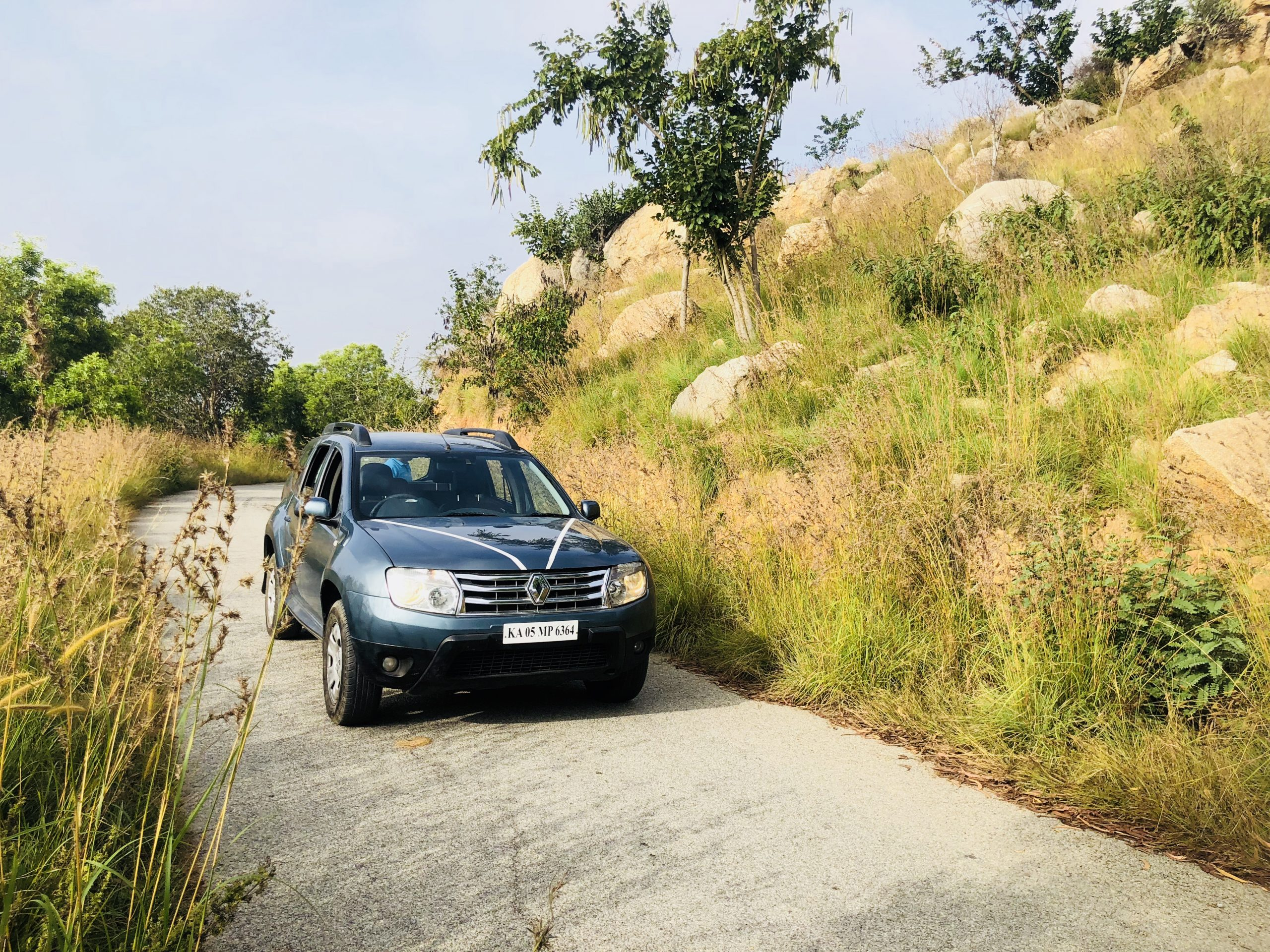 Renault Duster car on a dirt road