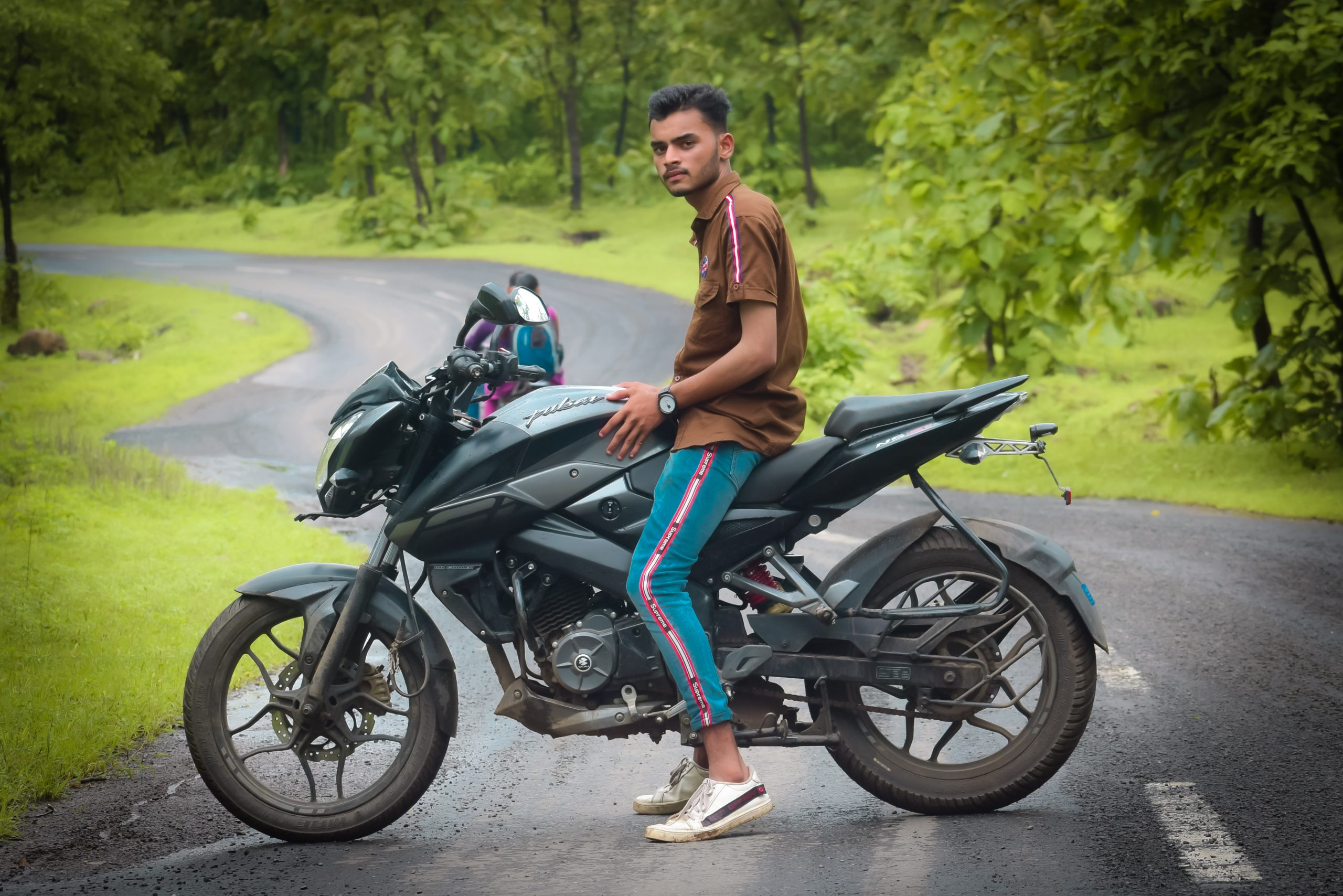 man posing on bike