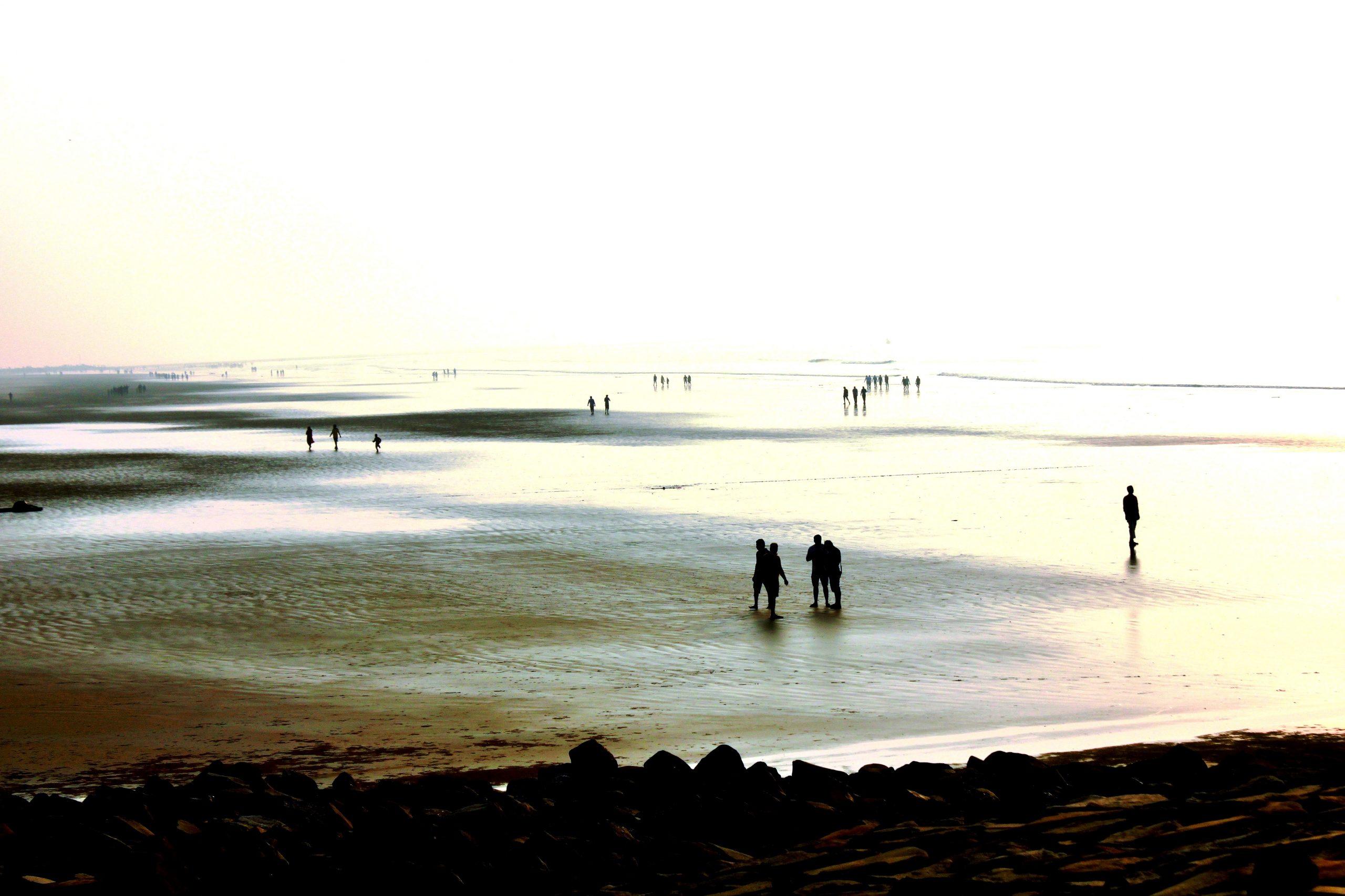 People walking beach side