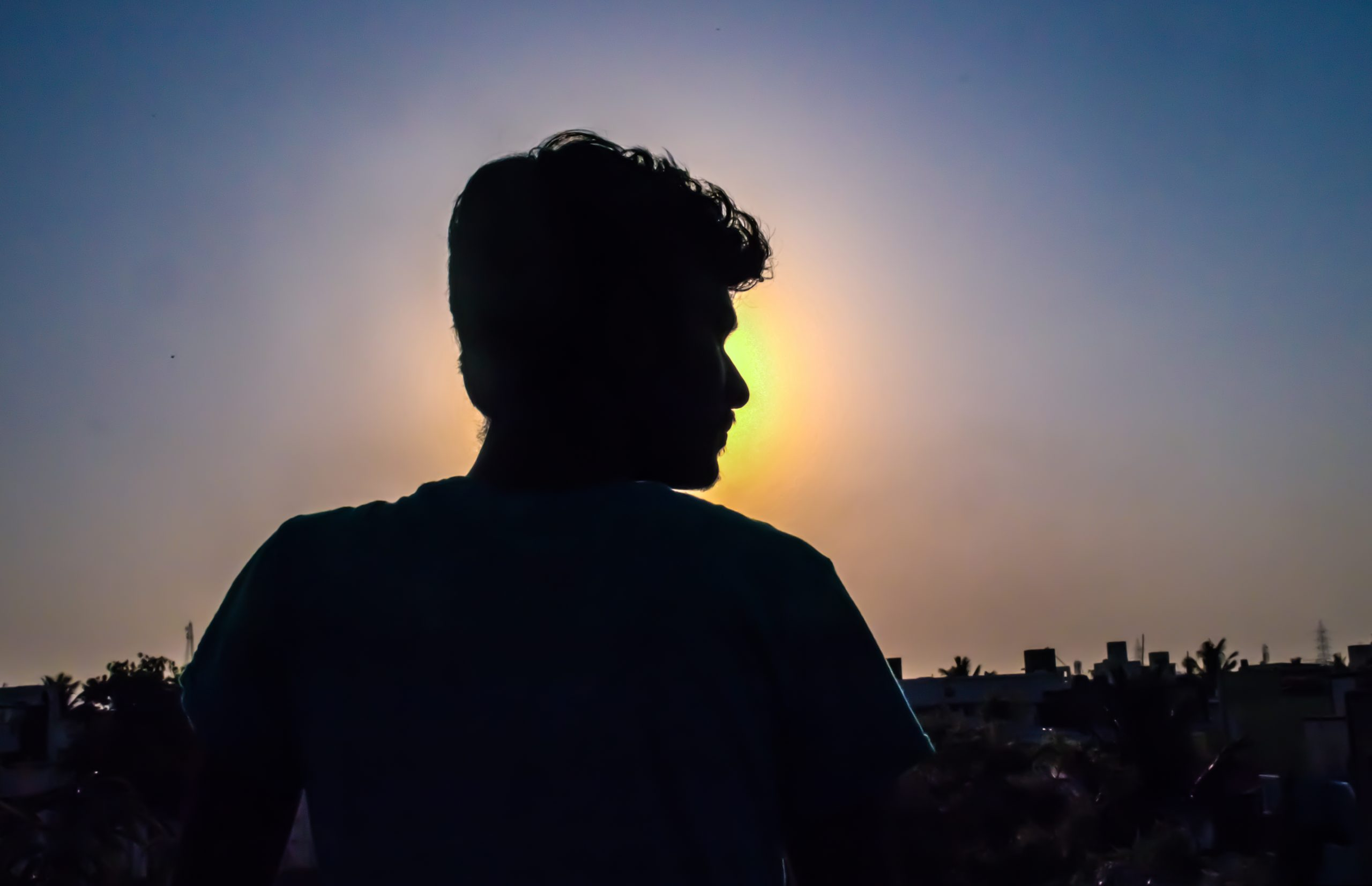 silhouette of man against the sun