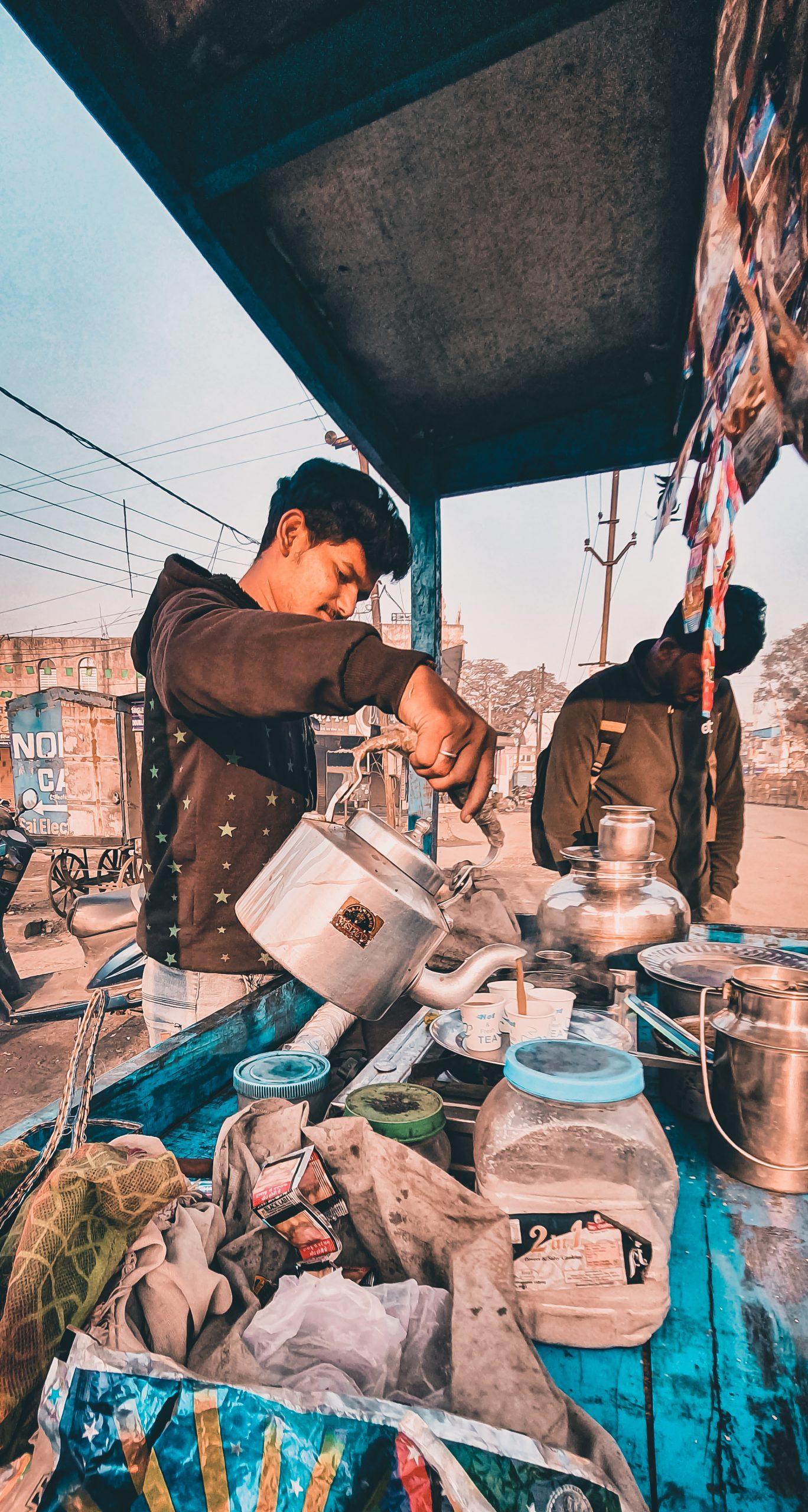 A boy selling tea in a street