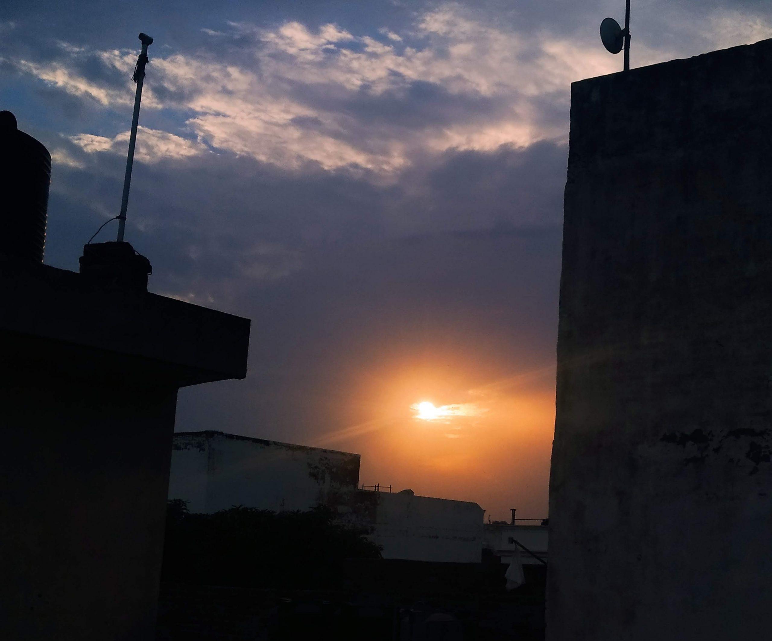 Sunset through a town