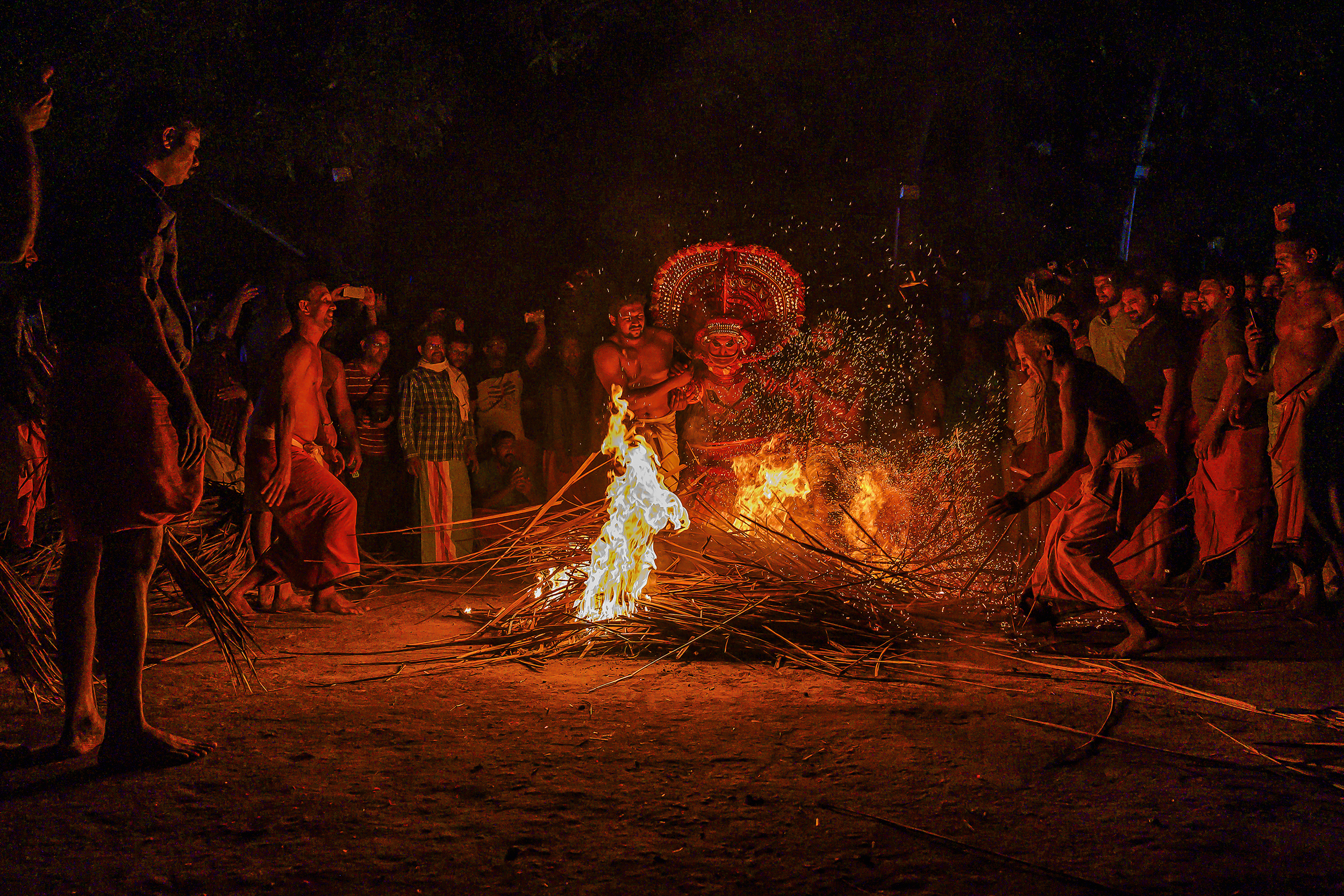Theyyam Devotees paying tribute to diety