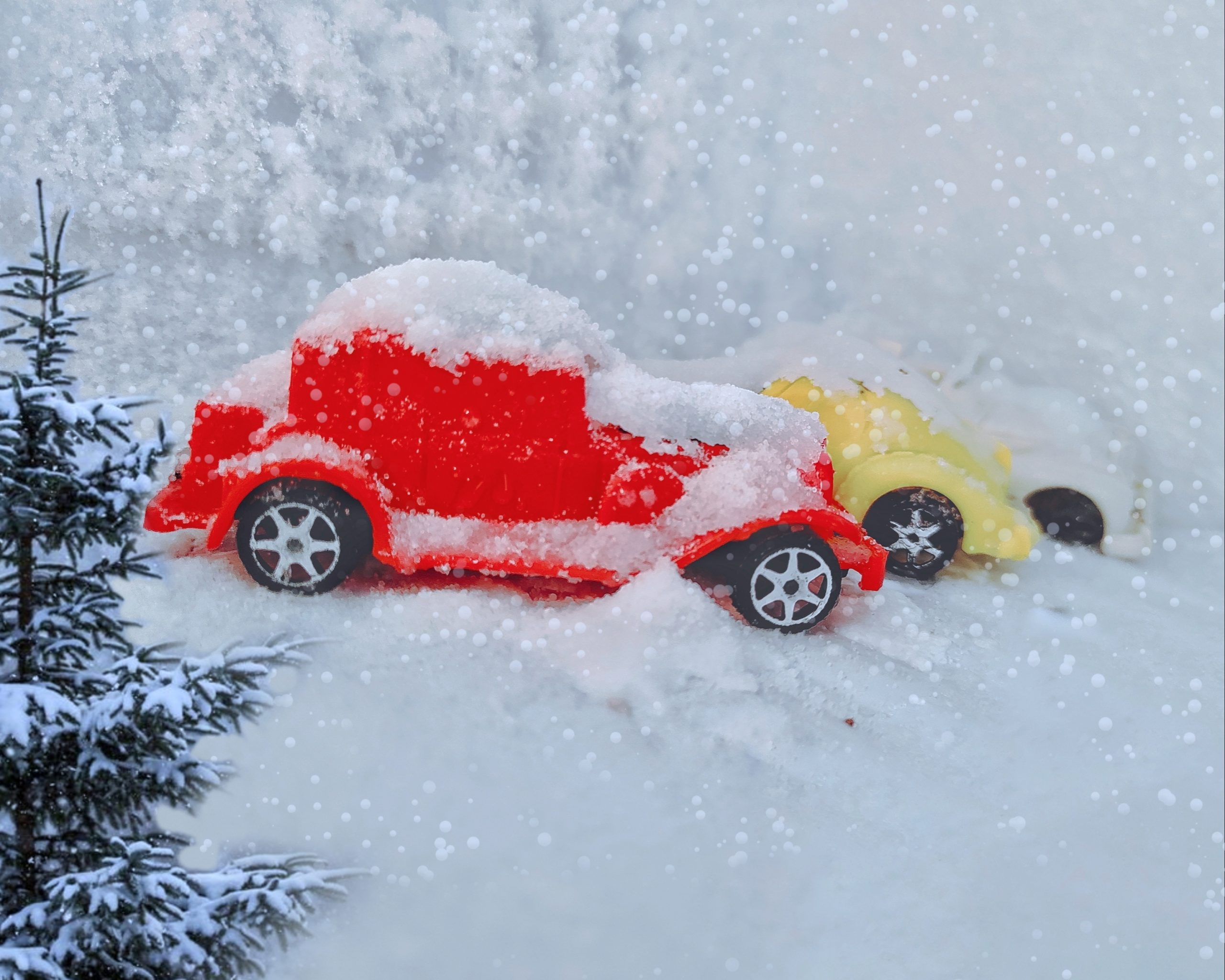 Toy cars in snowfall