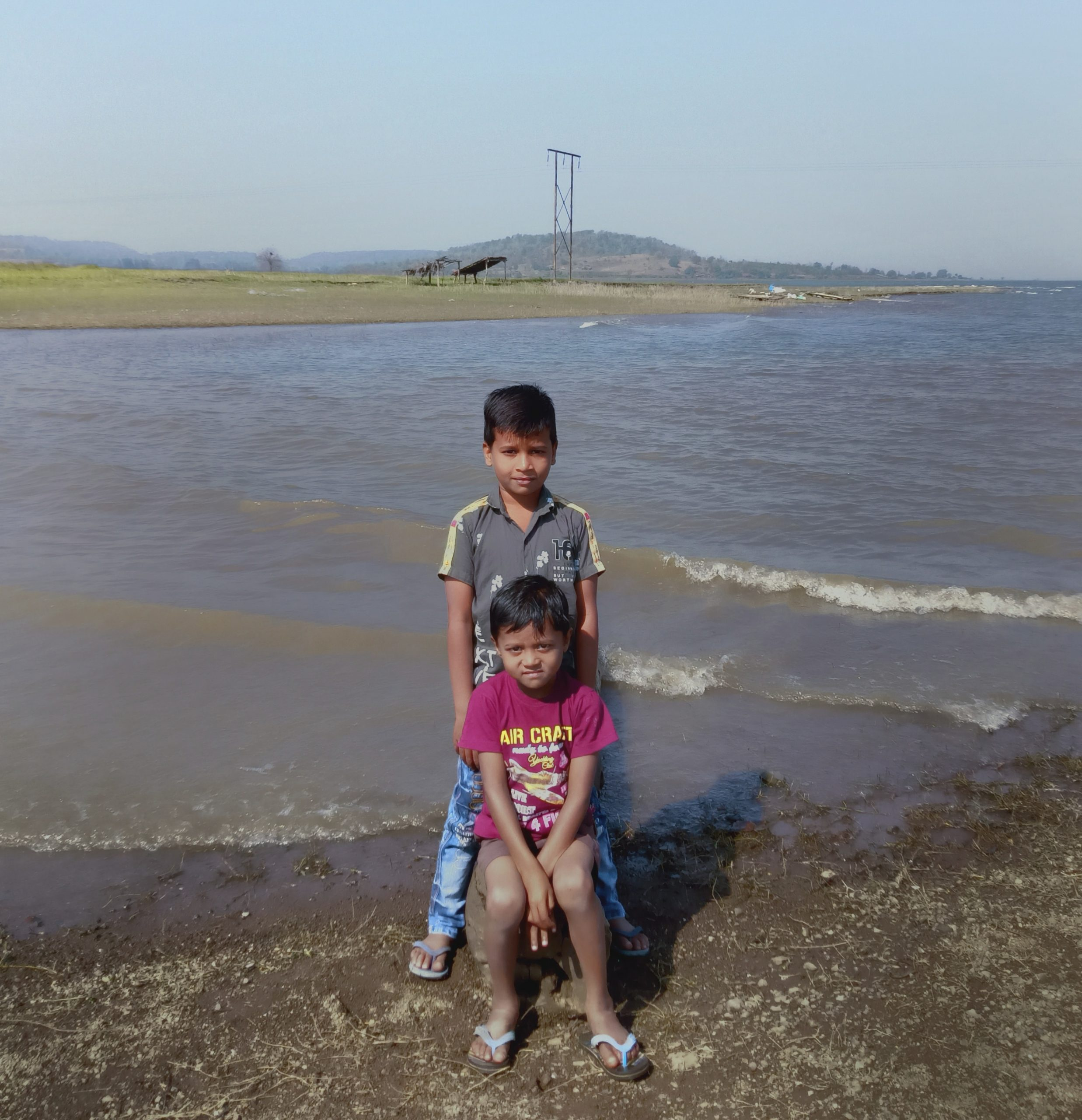Two little boys at a riverbank