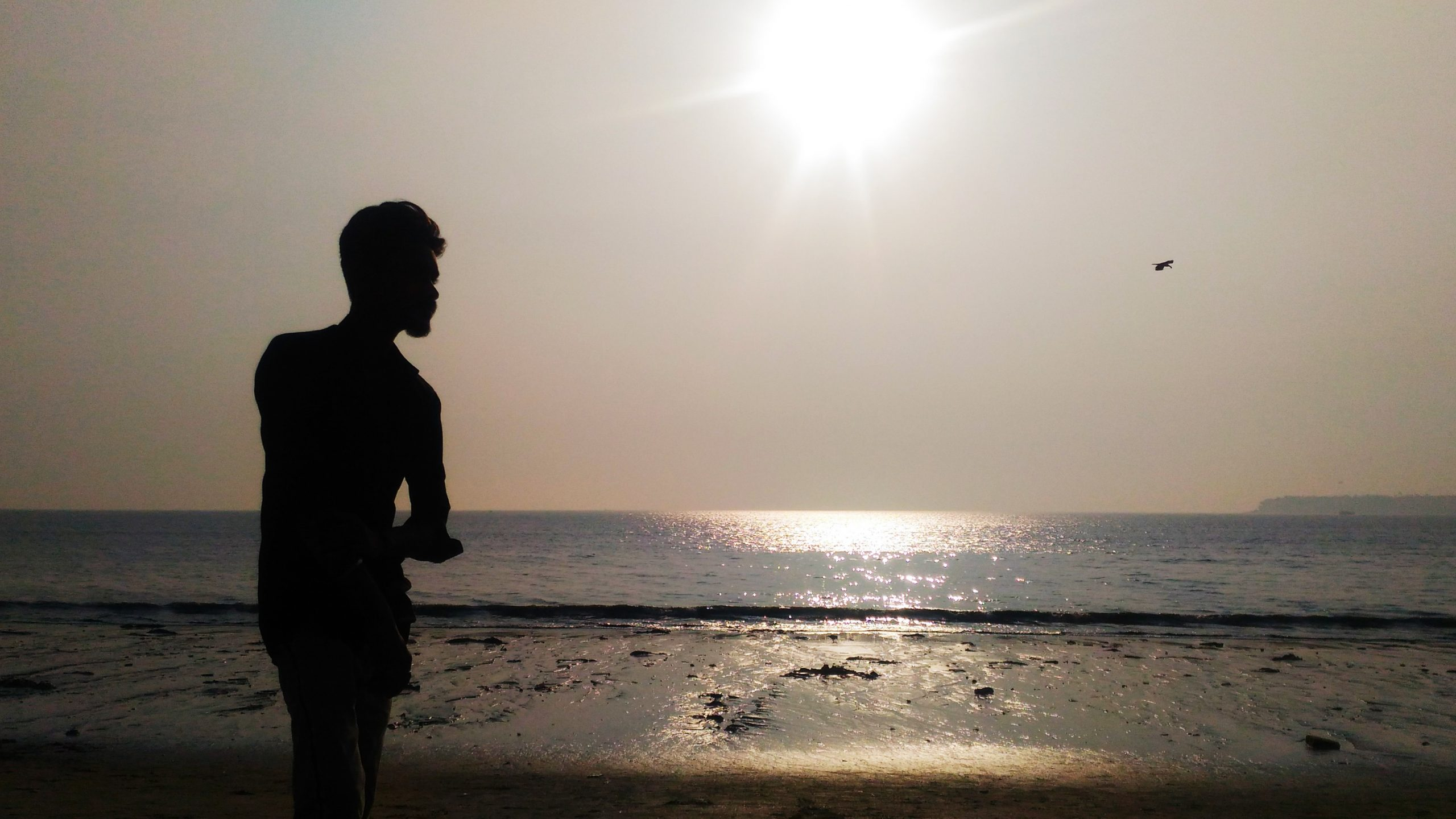 Man enjoying sunshine on beach