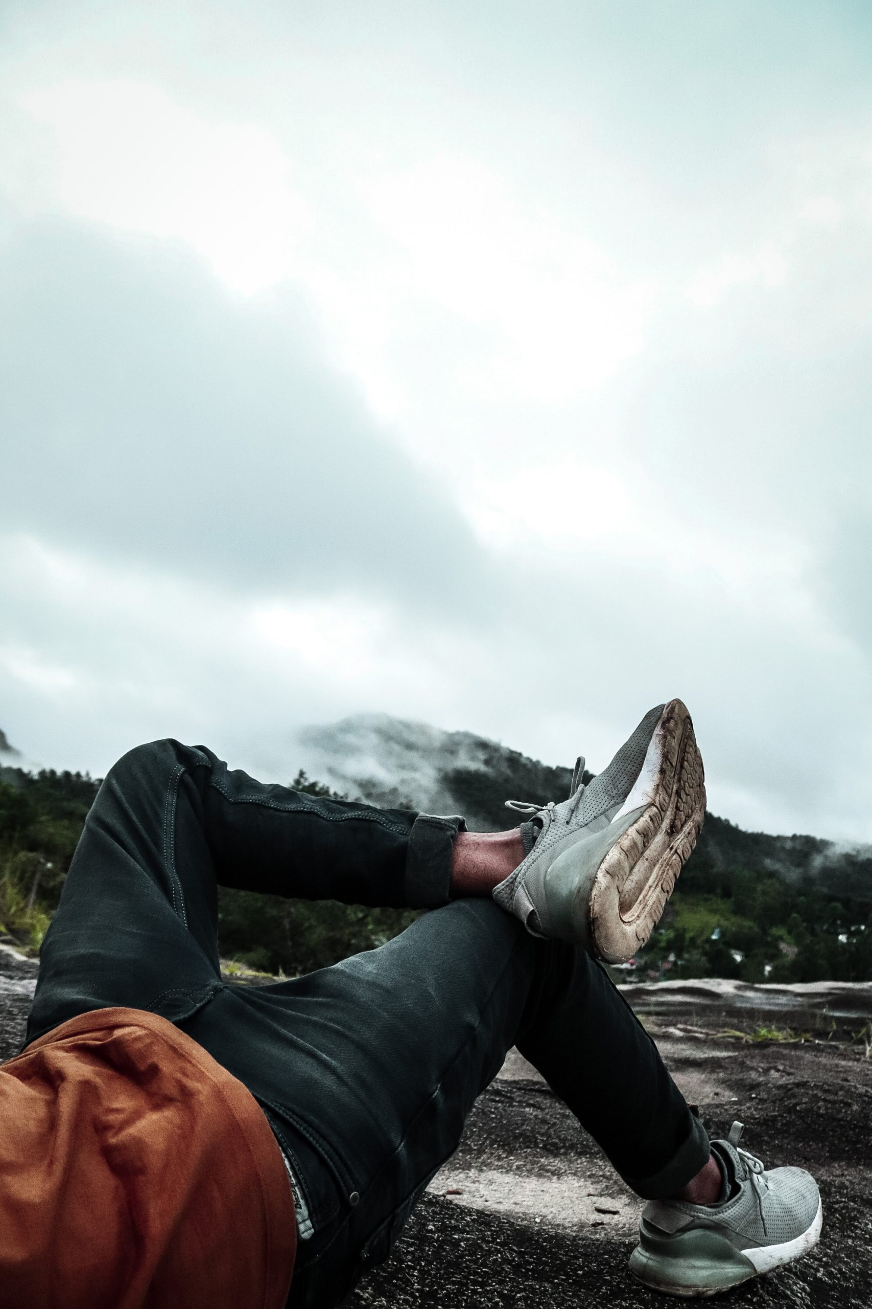 Boy laying down in hills