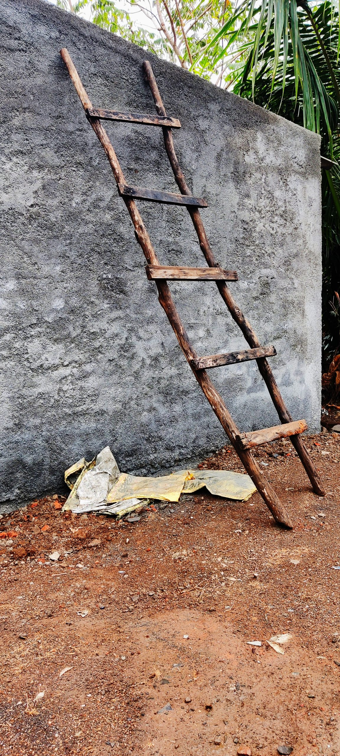Ladder standing beside the wall