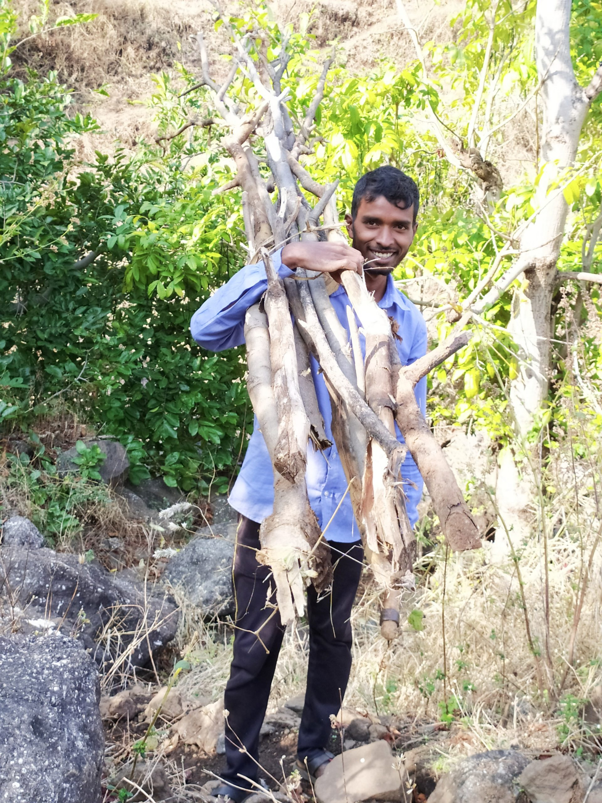 A village boy carrying woods