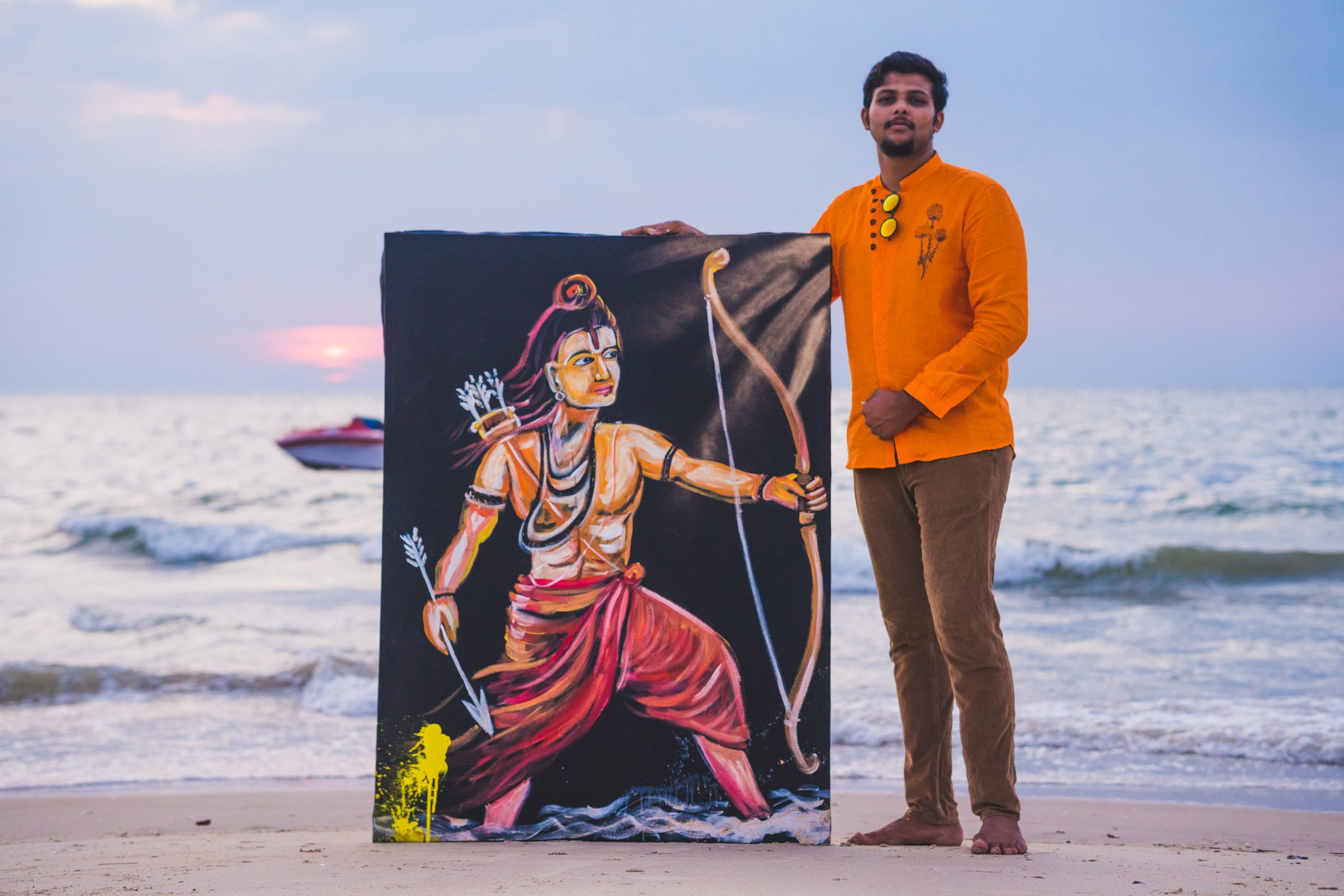 Artist showing a painting of Lord Rama