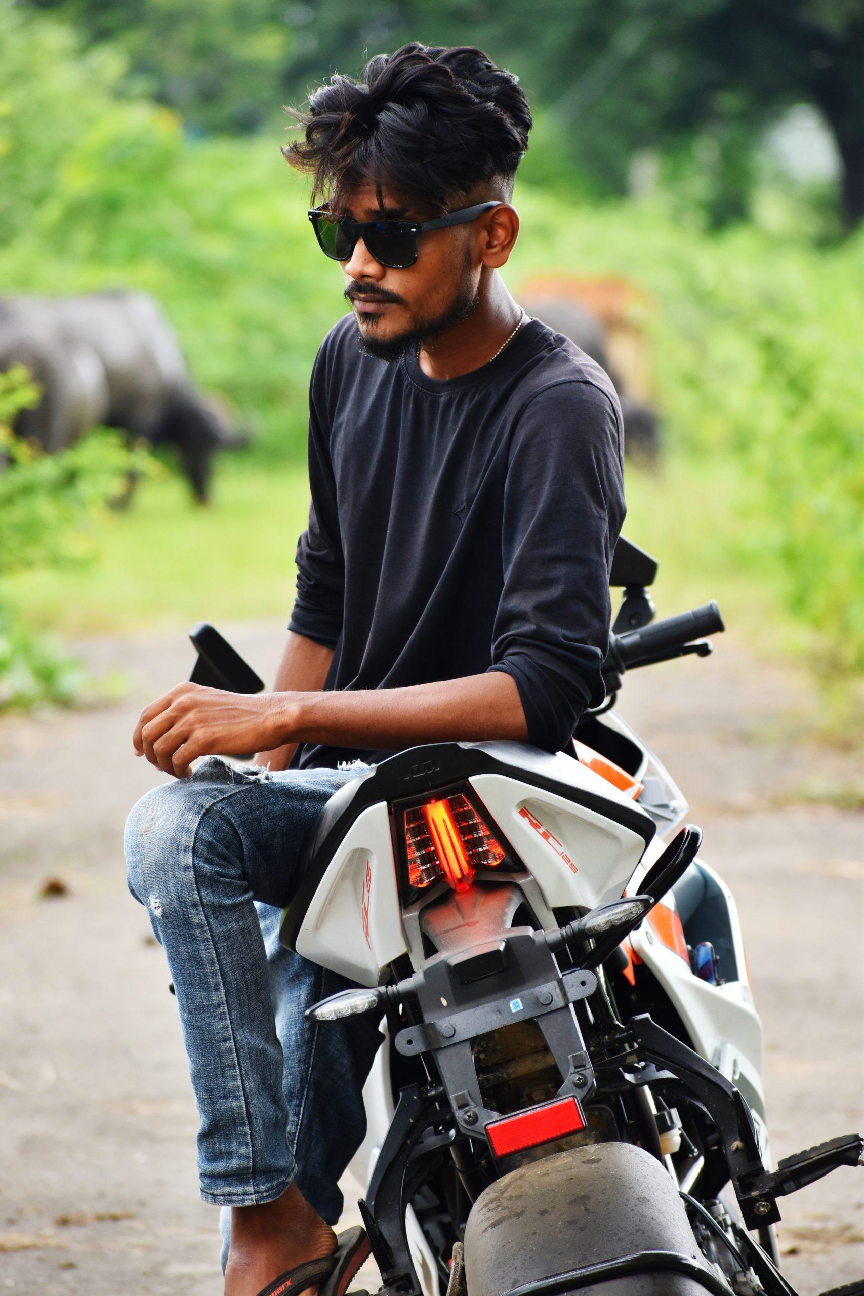boy sitting on a bike