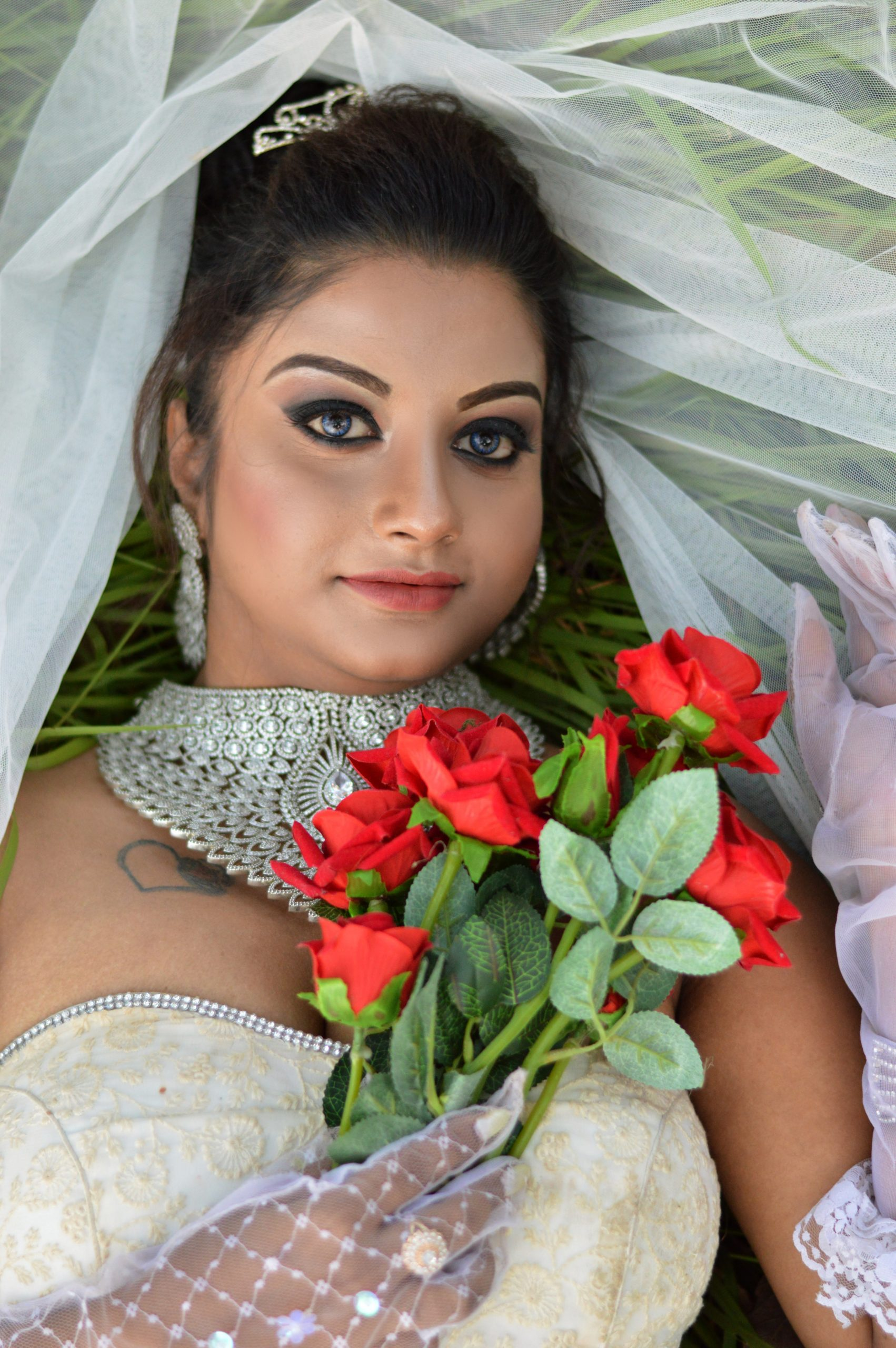 bride posing with flowers