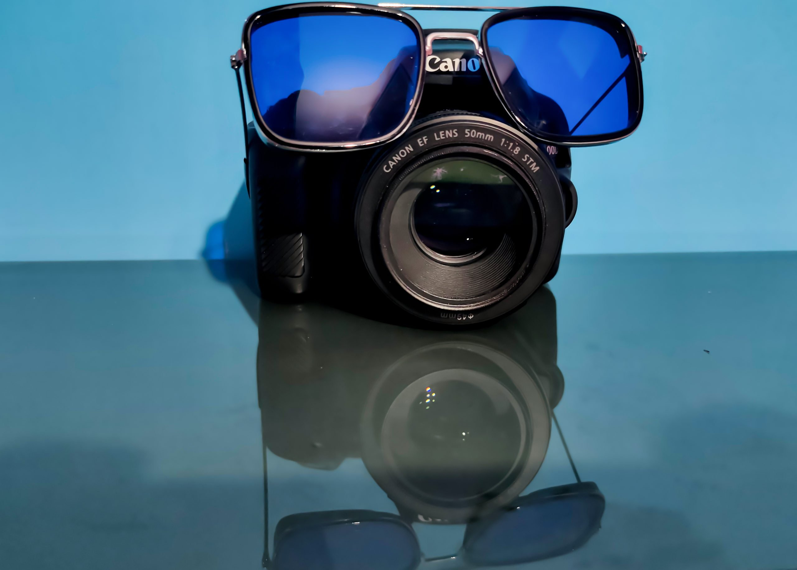 camera and sunglasses