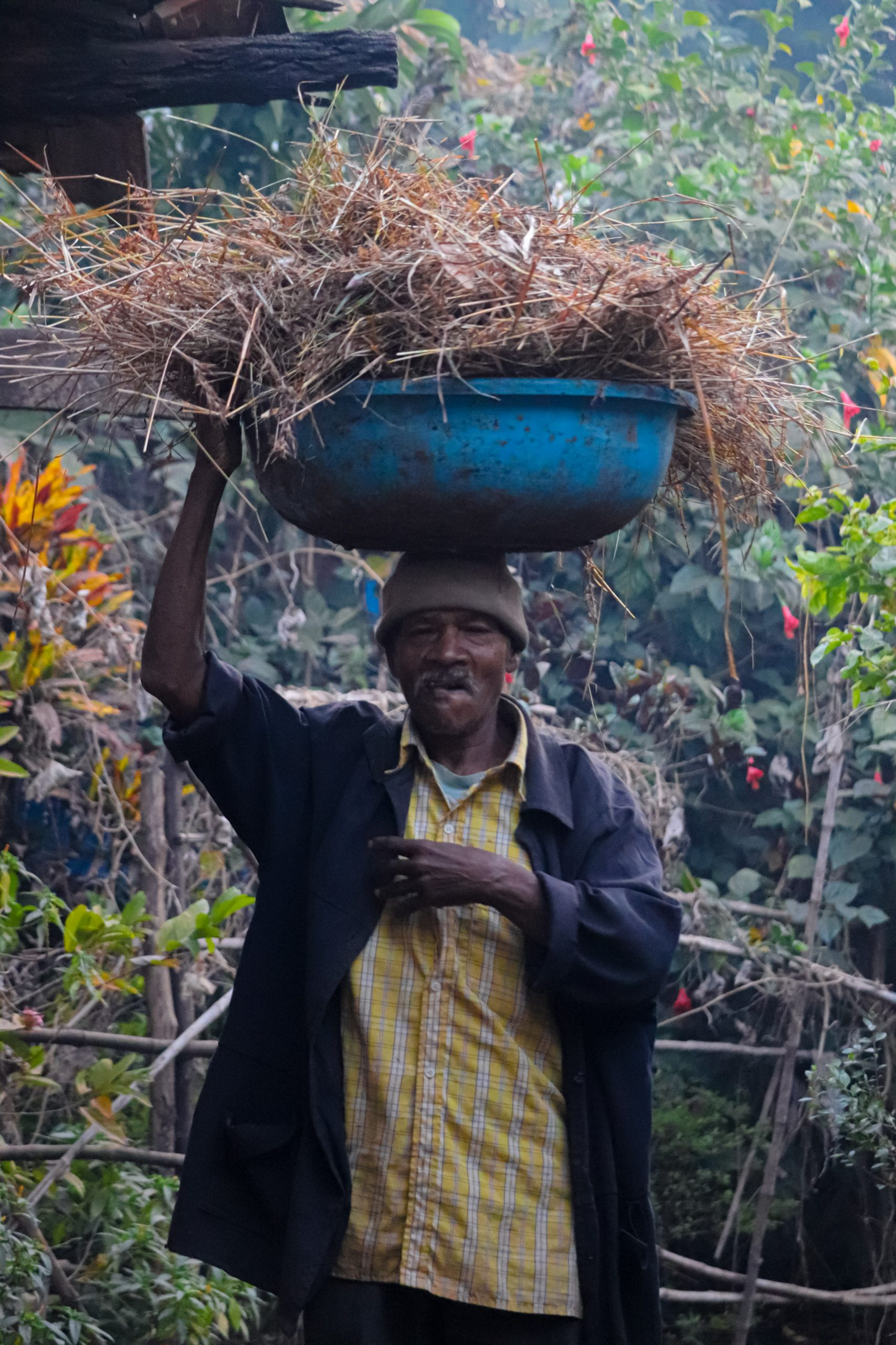 A village man carrying waste on his head