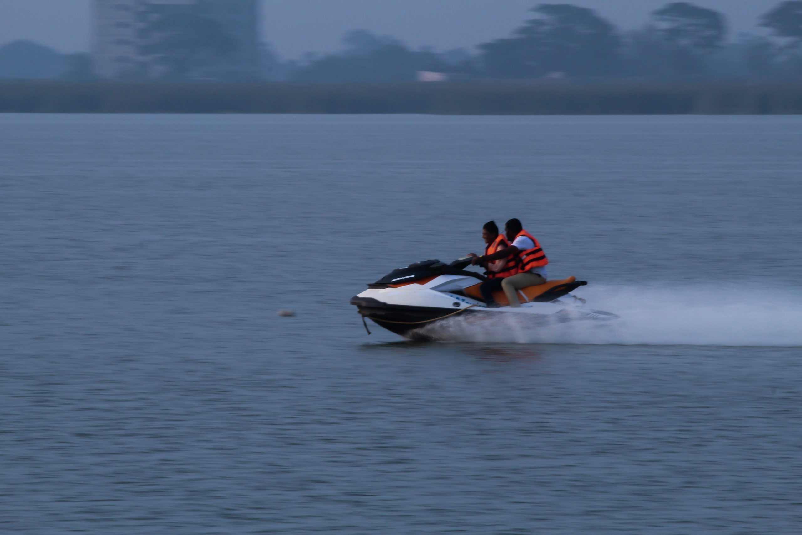 Men driving a speed boat