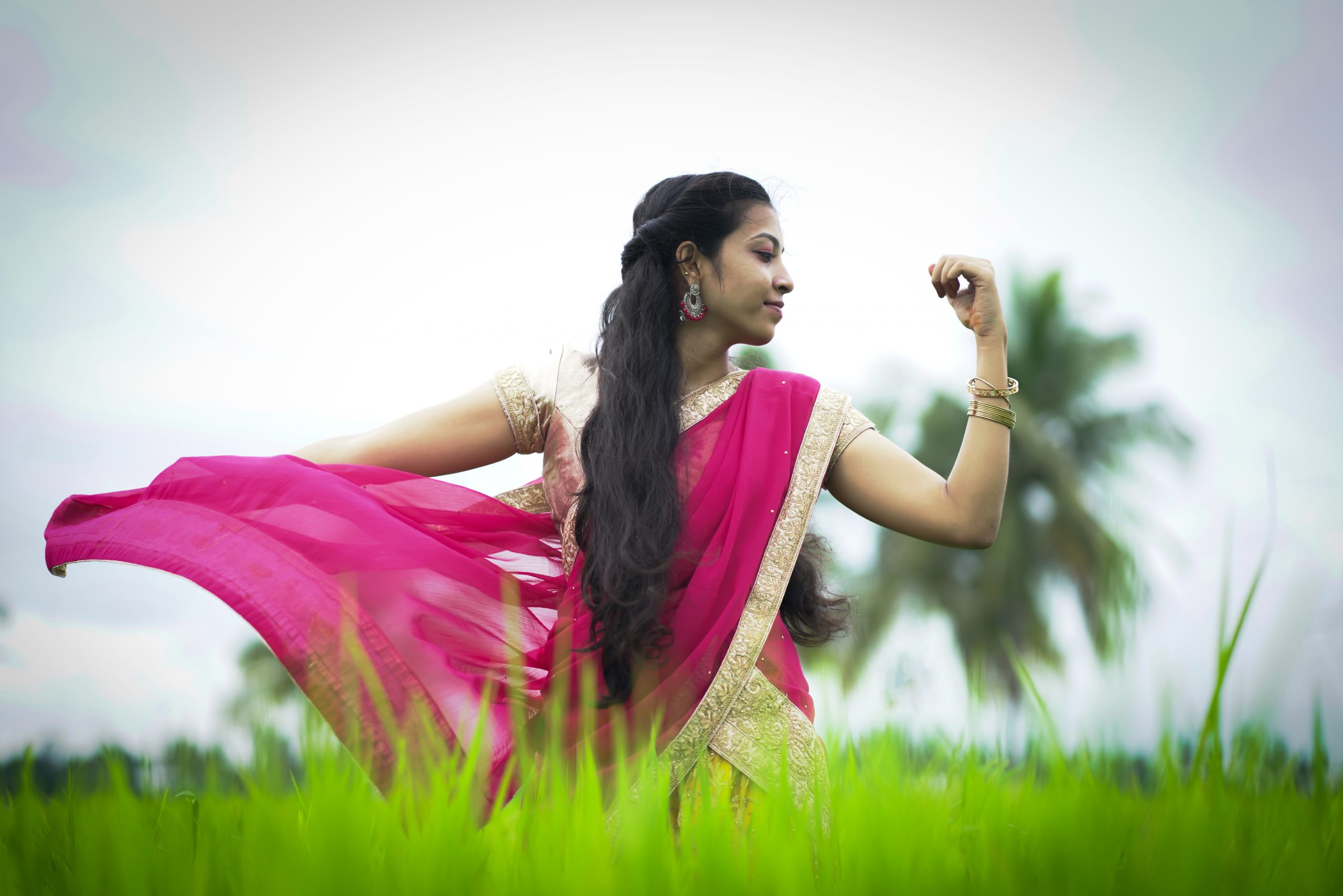 A Indian girl dancing in fields