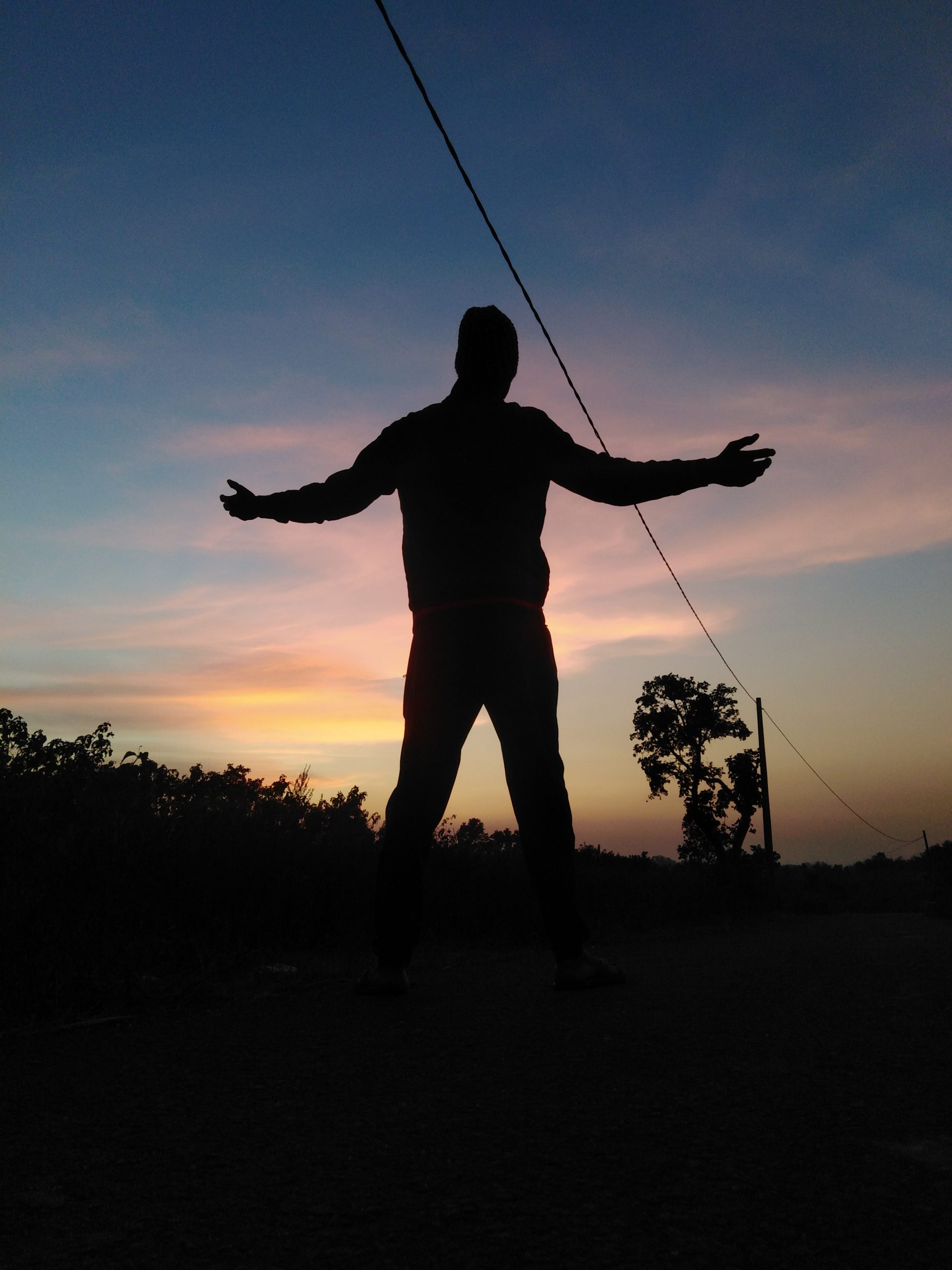 silhouette of a man posing