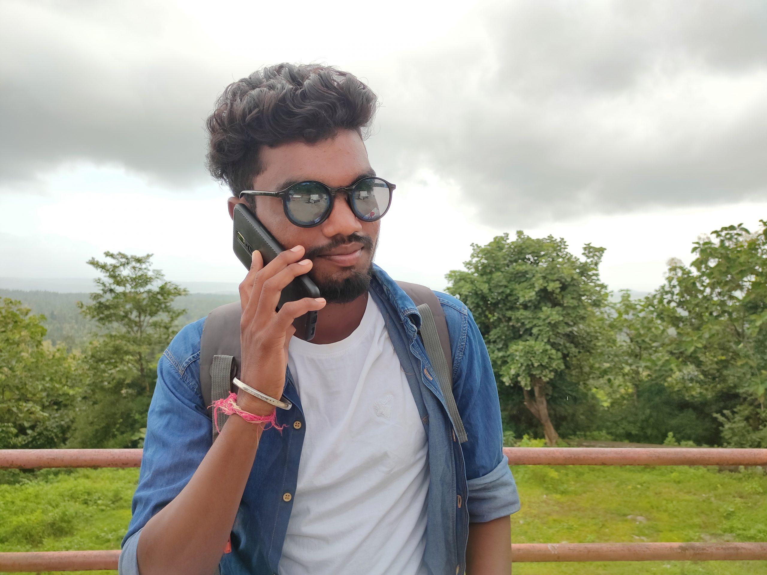 A boy attending phone call