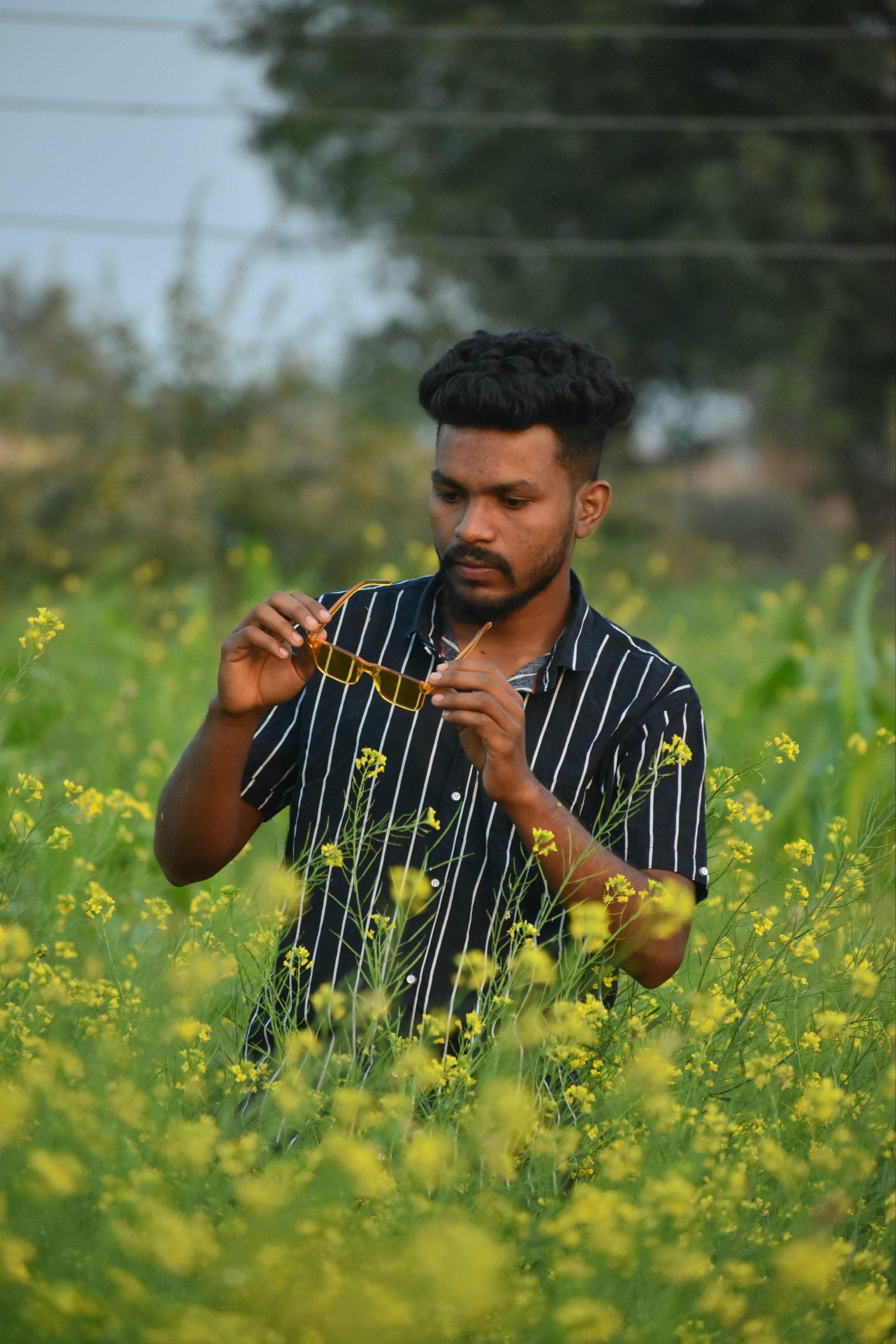 A boy in mustard plant field