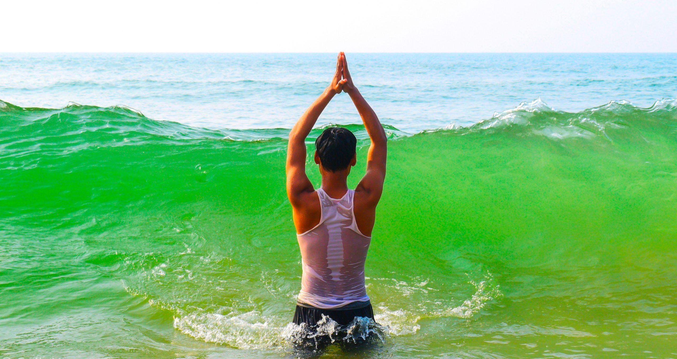 A boy praying god in sea water