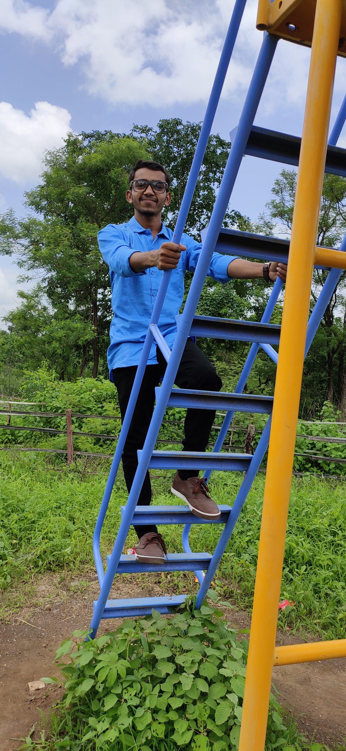 boy climbing steps
