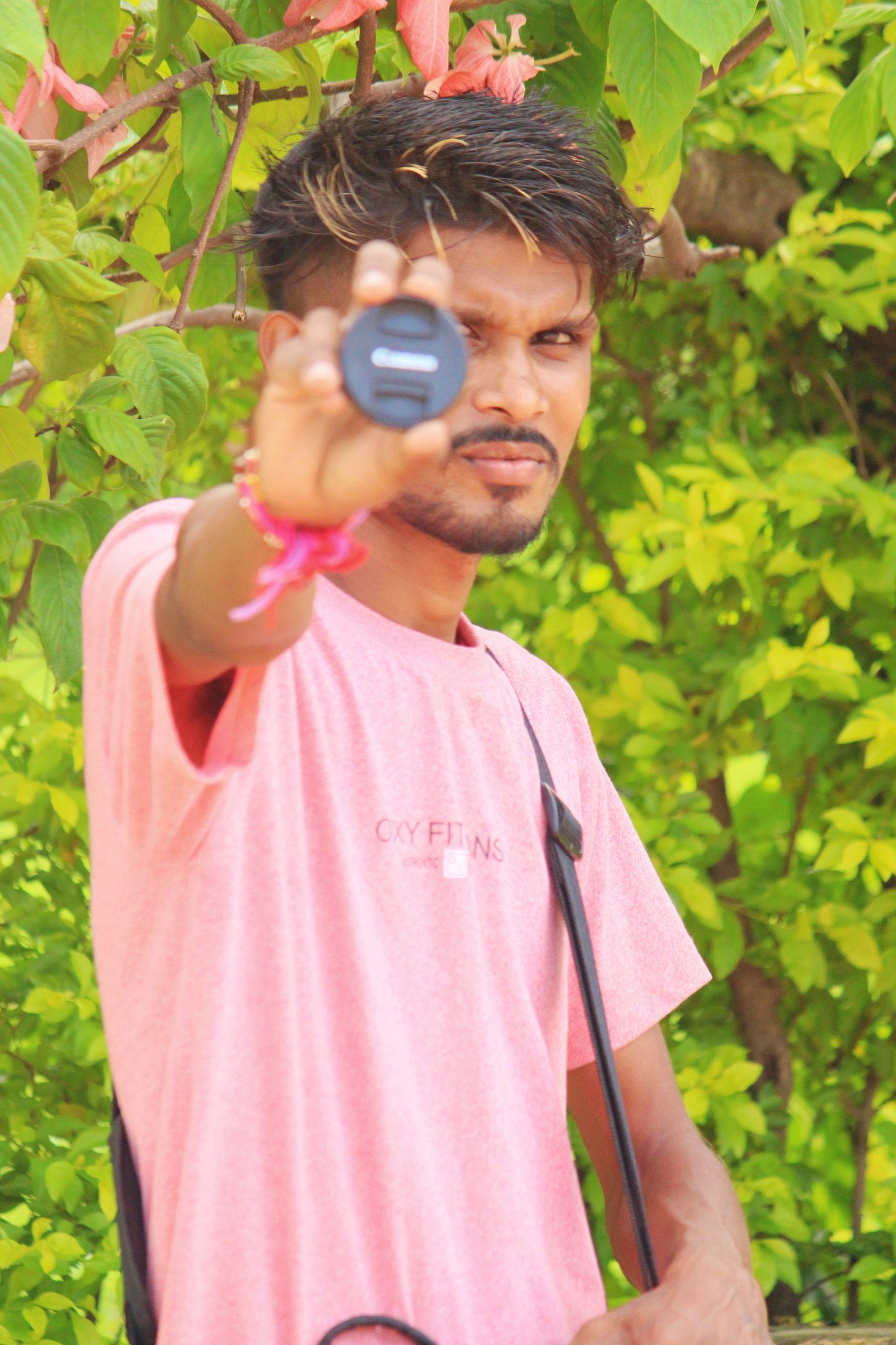A boy showing lens cap