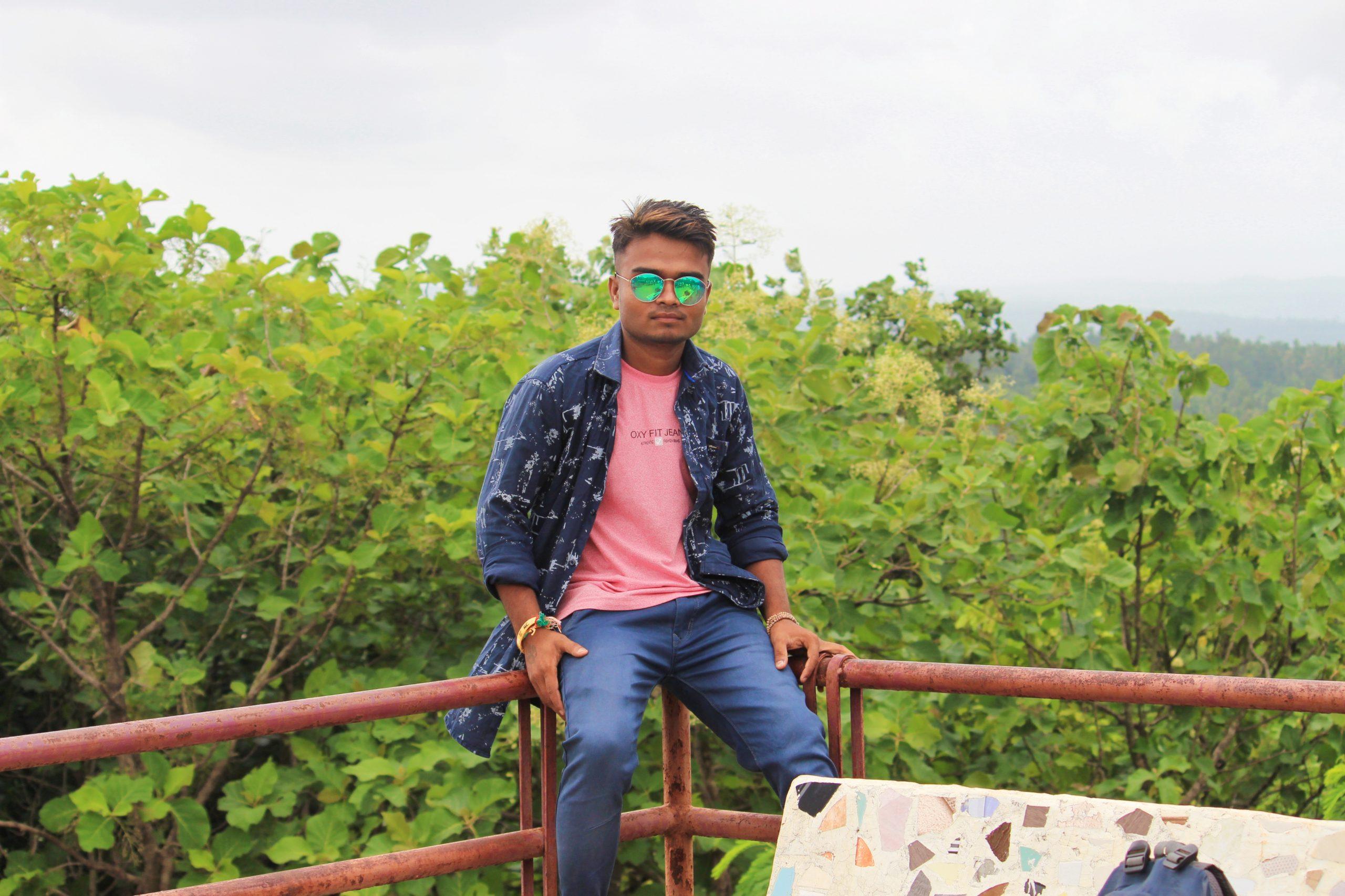 A boy sitting on railing