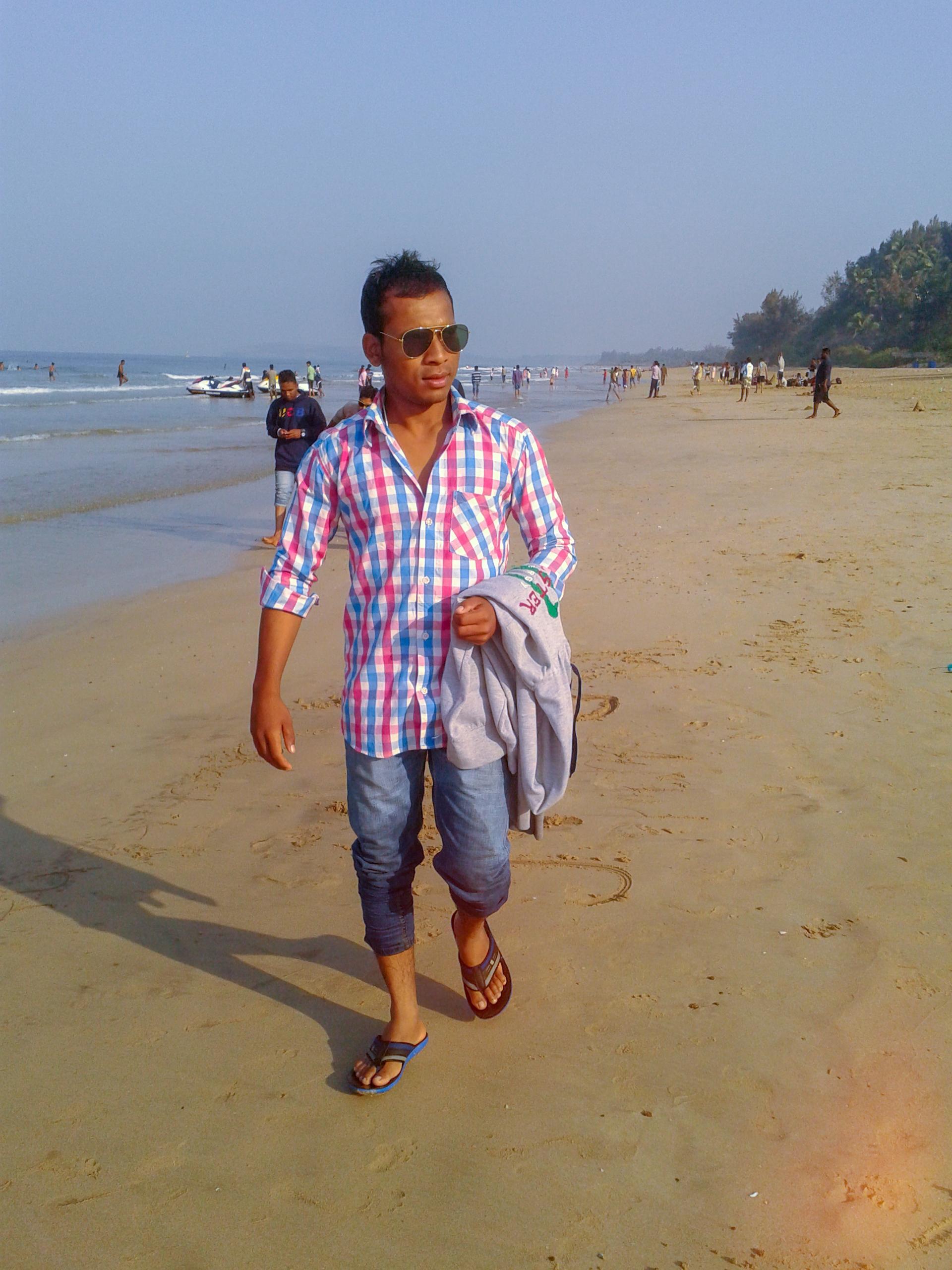 A boy waling on a beach