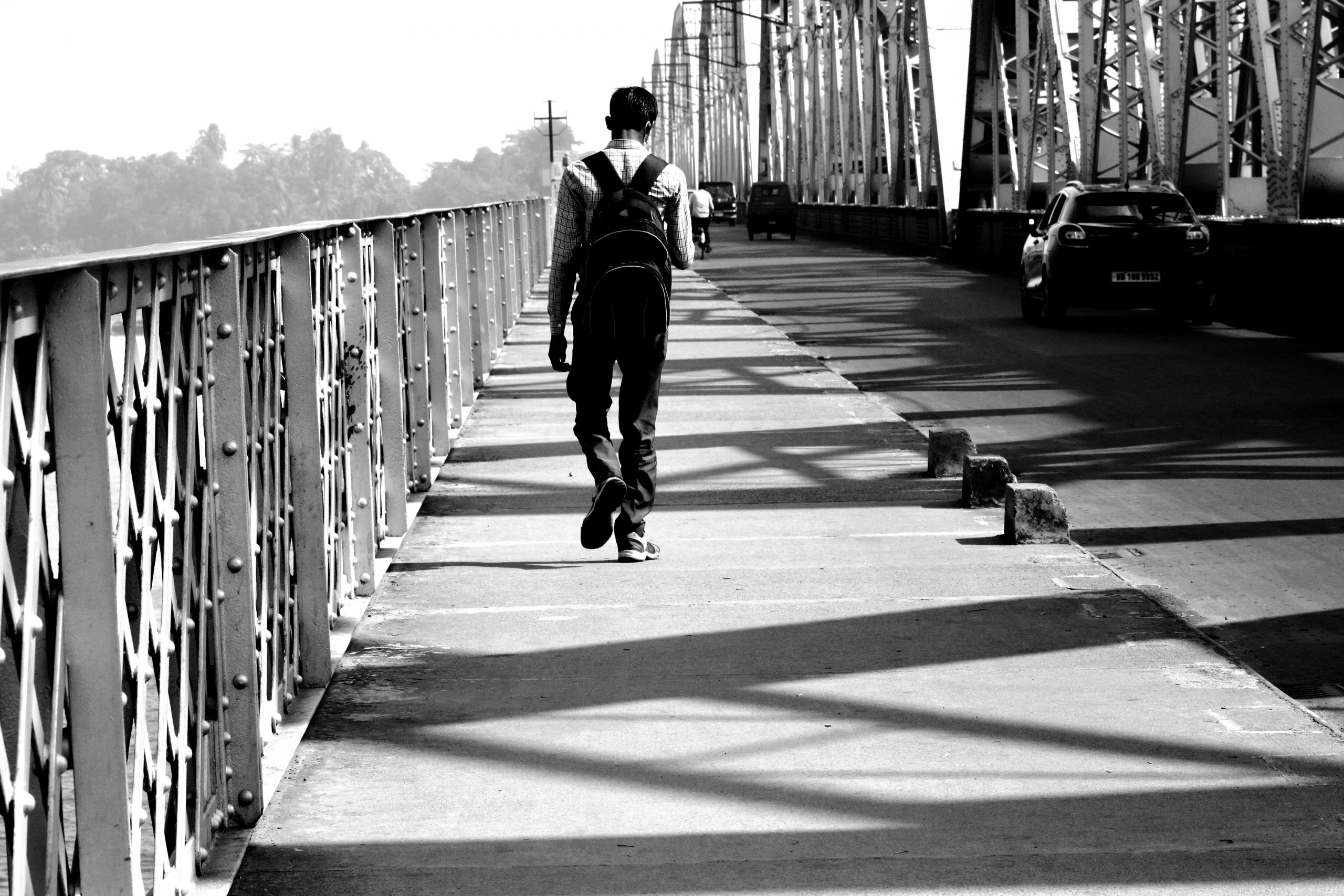 A boy walking on a bridge