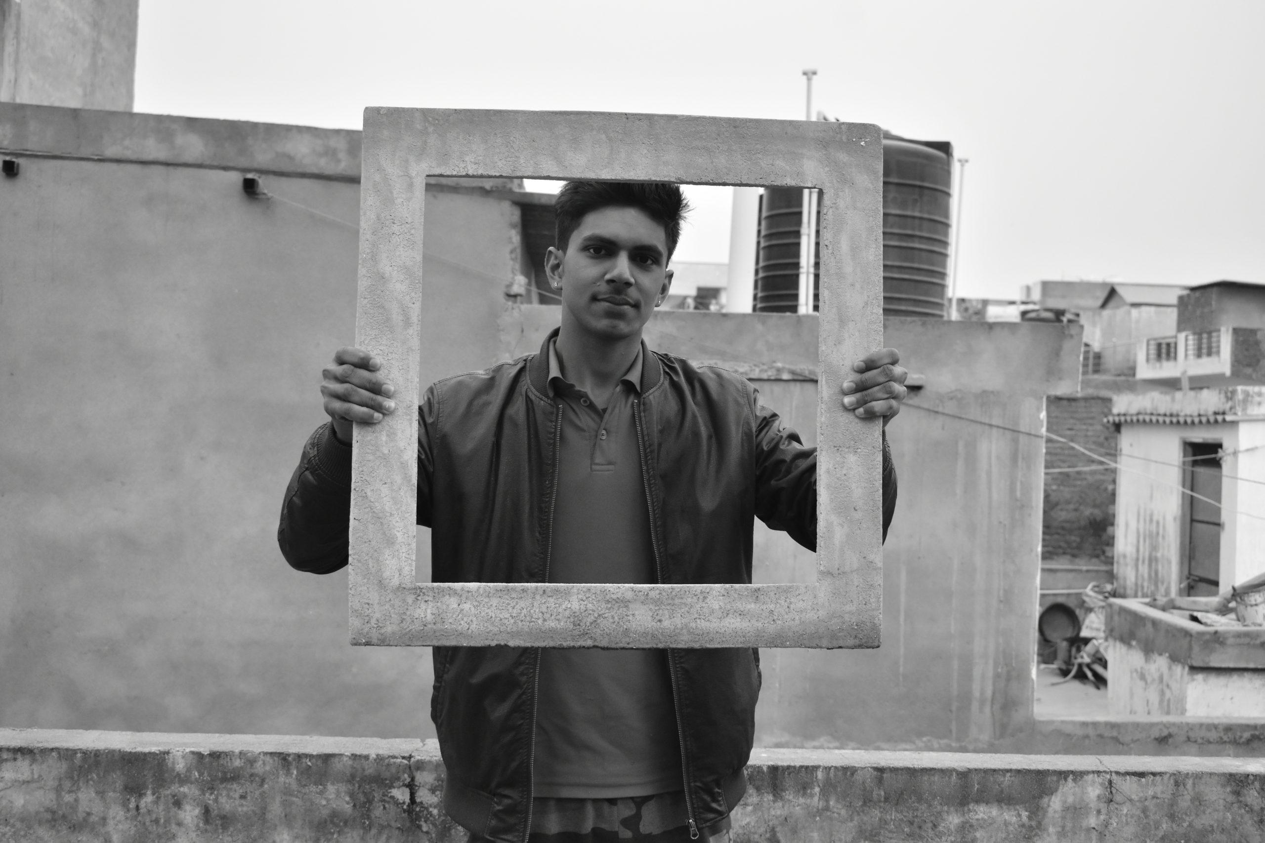 A boy with a frame