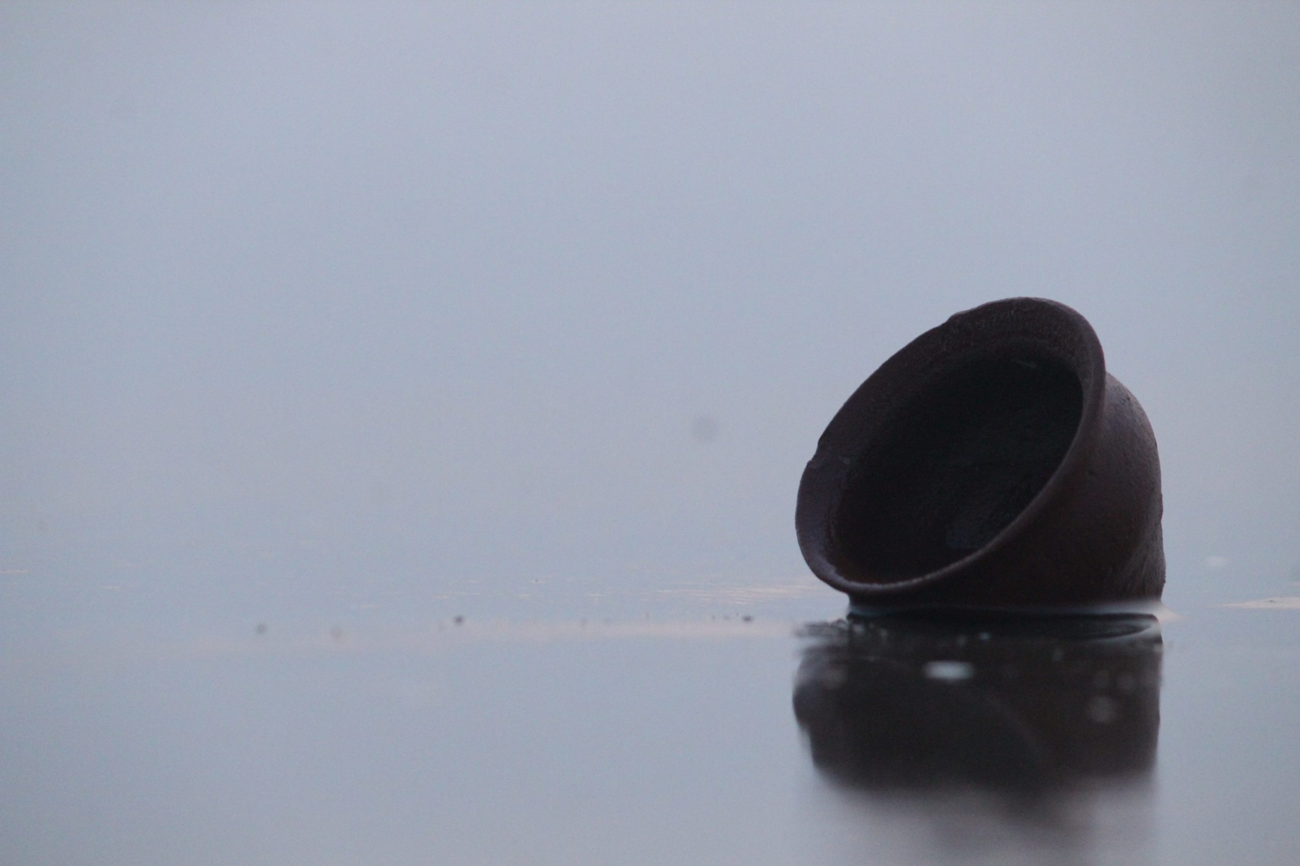 A clay cup in water