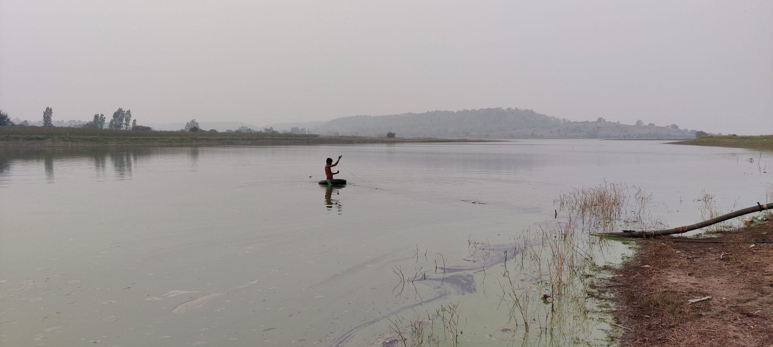 A fisherman in a pond