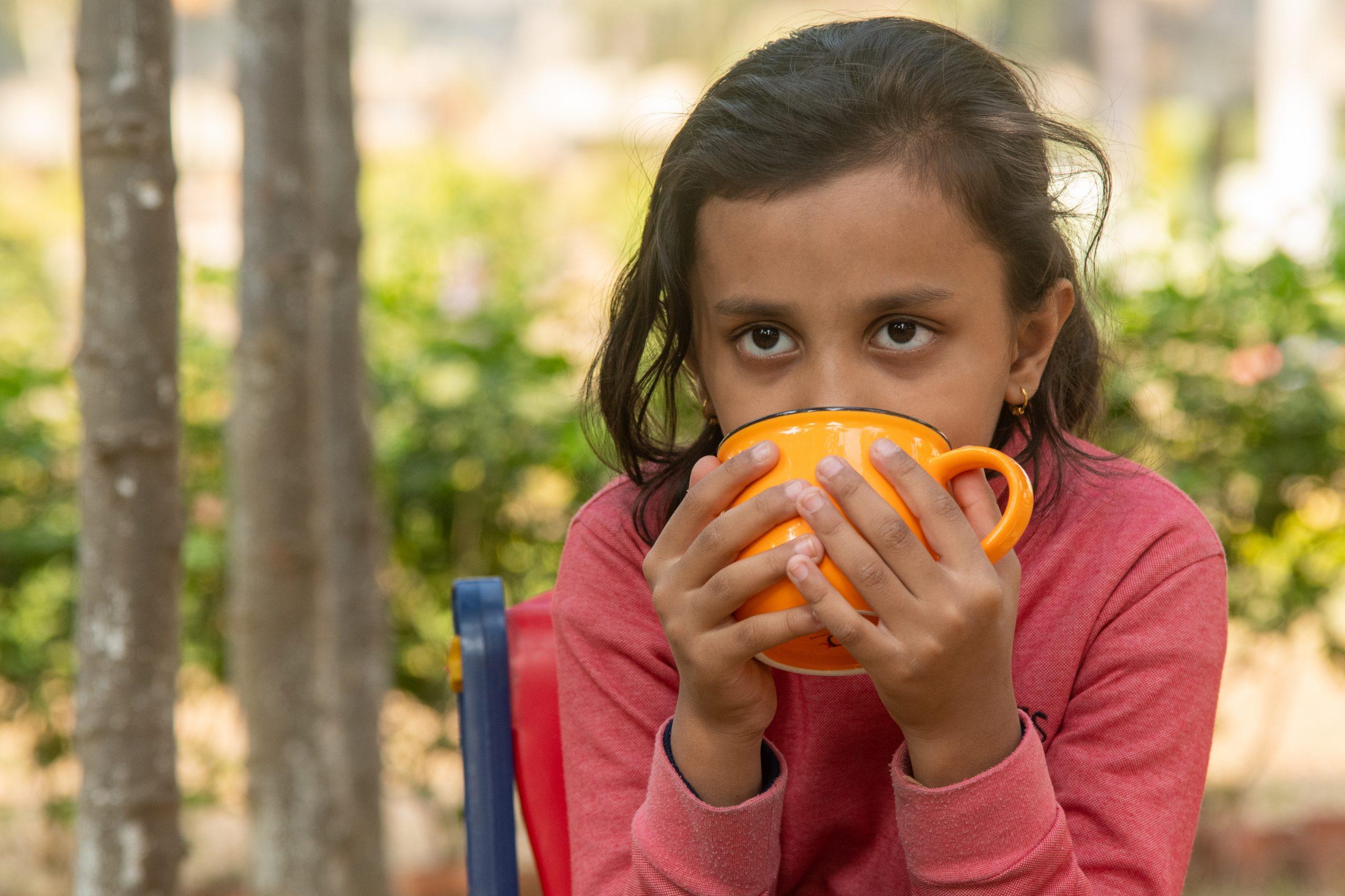 A girl taking tea