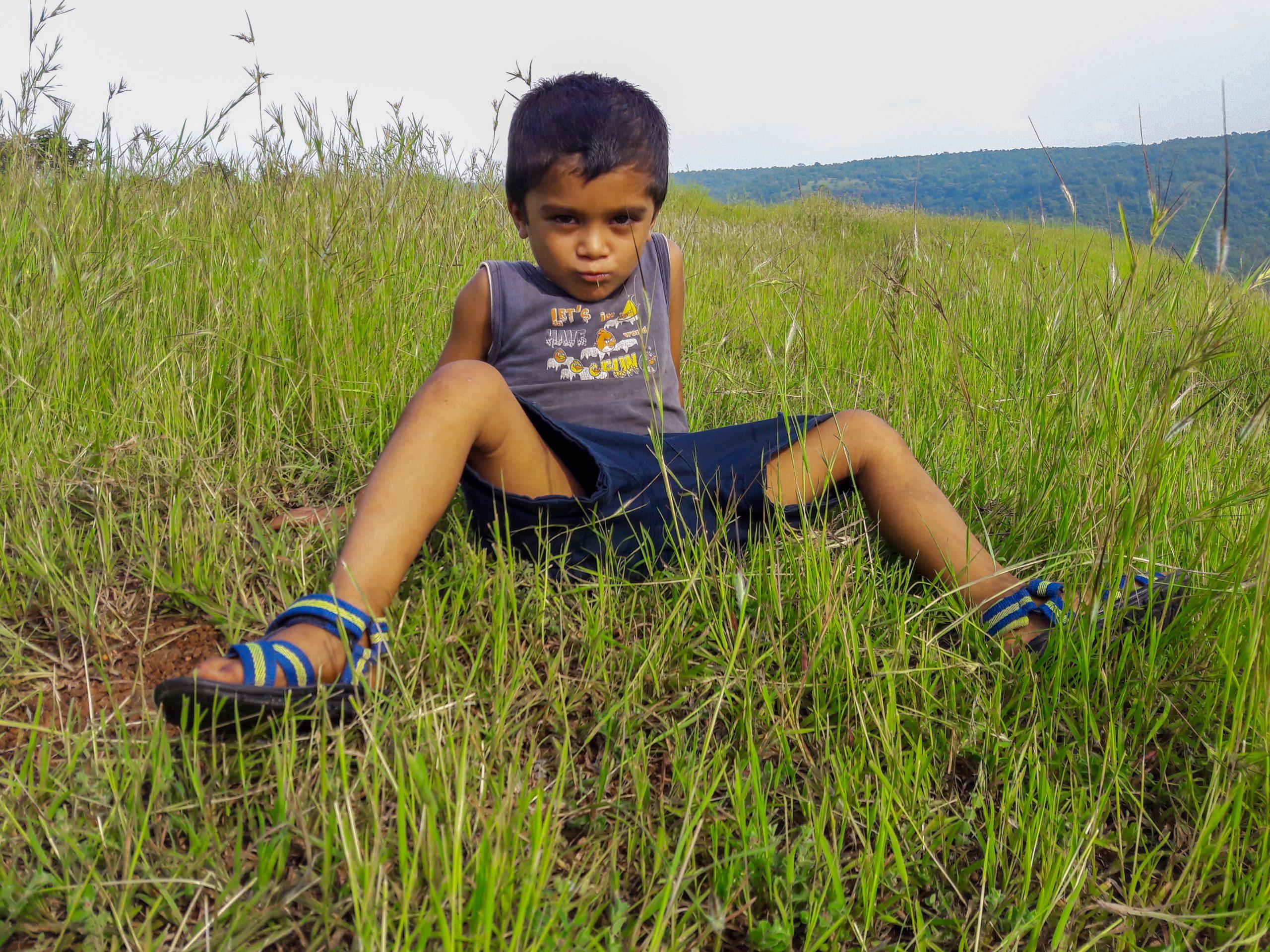 A kid on grass