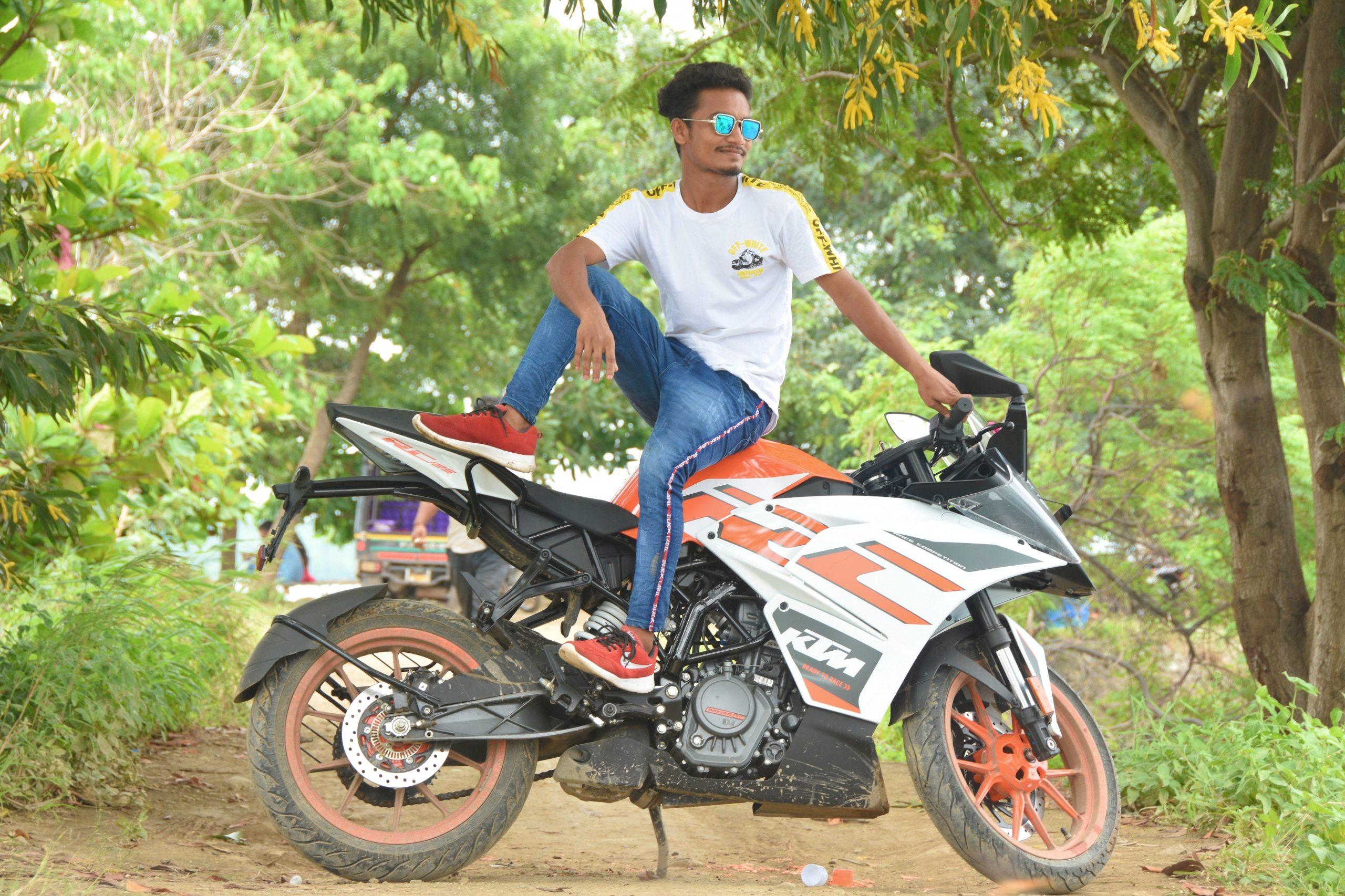 Boy sitting over bike and posing