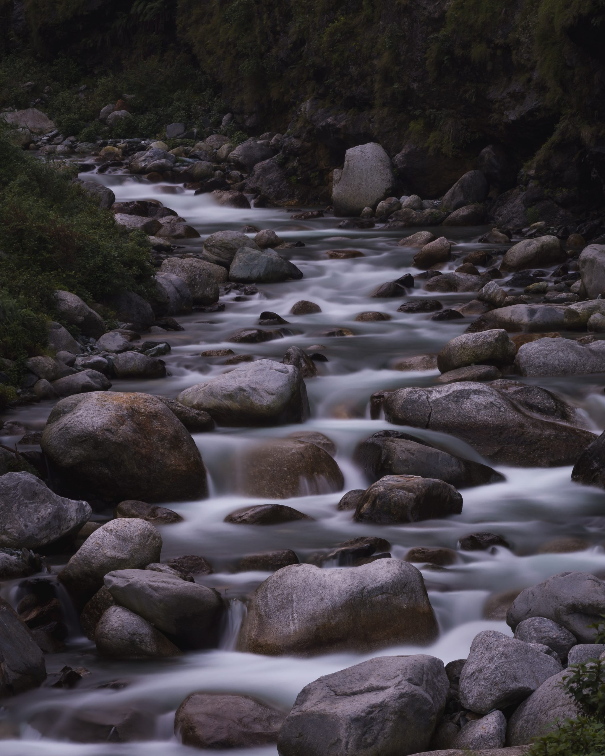 A river flowing through stones