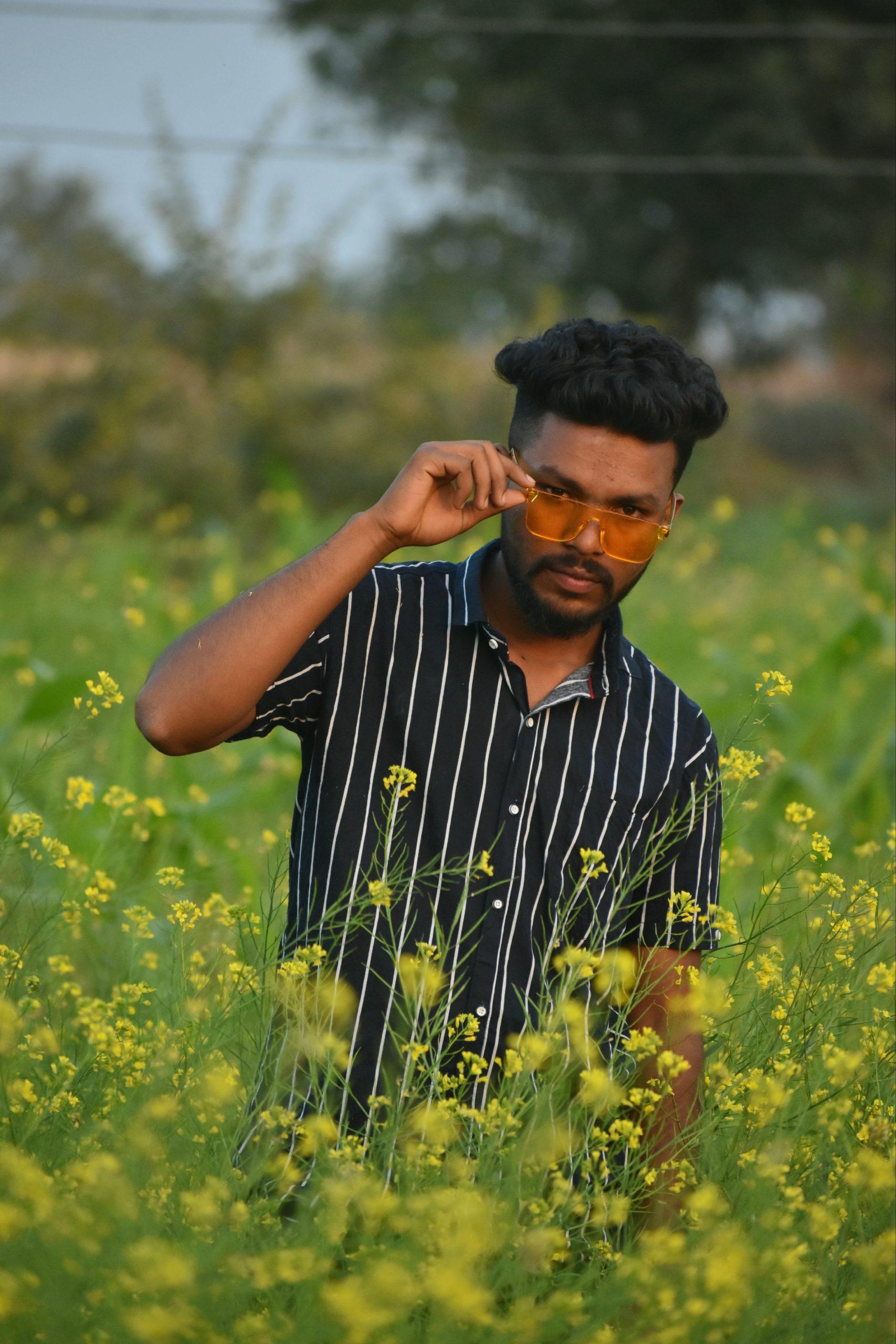 A stylish boy in mustard plant field
