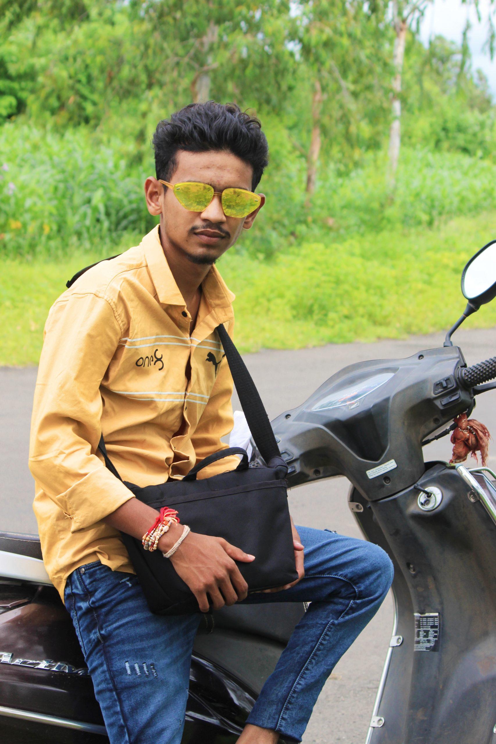 A stylish boy on a scooter