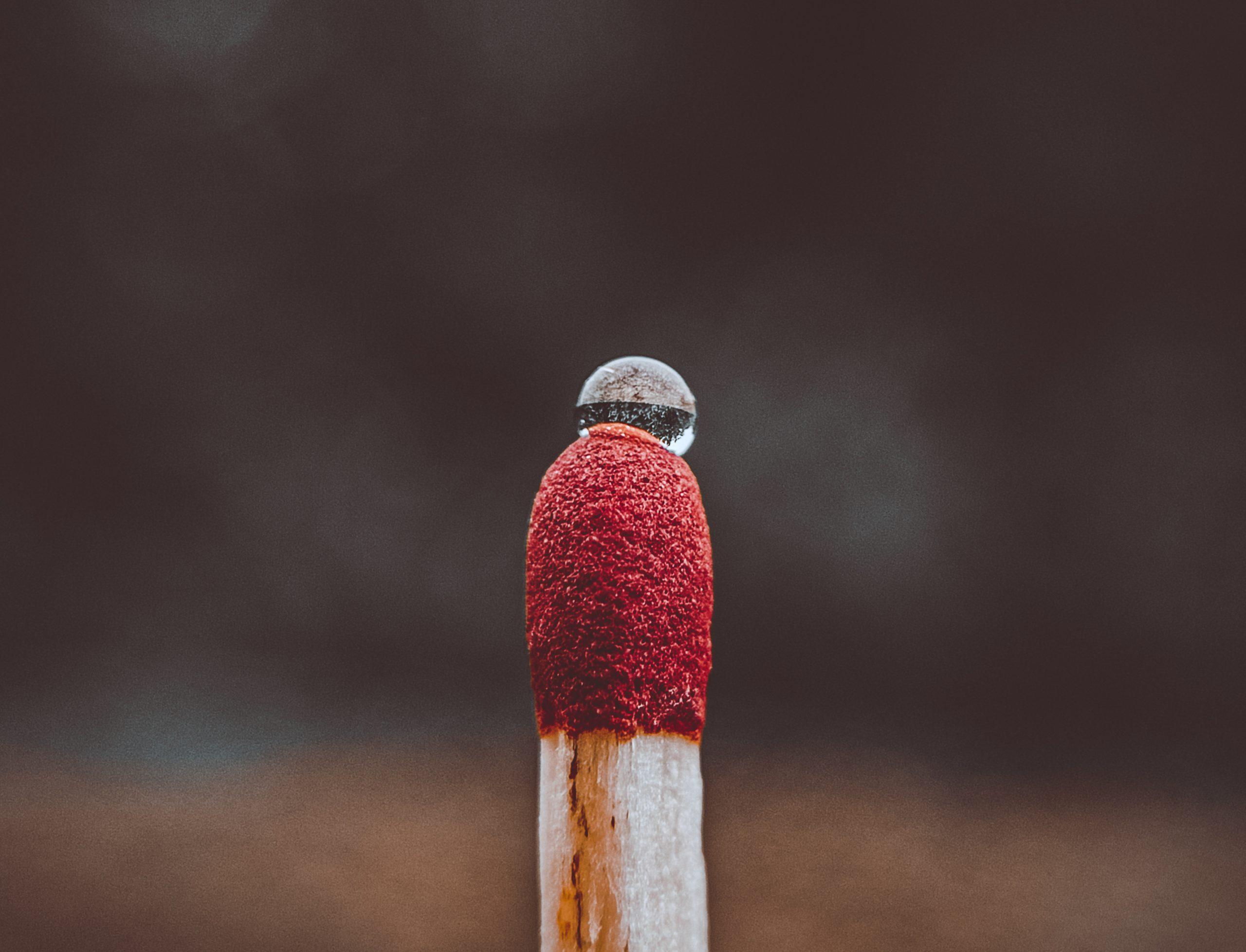 A water drop on a matchstick