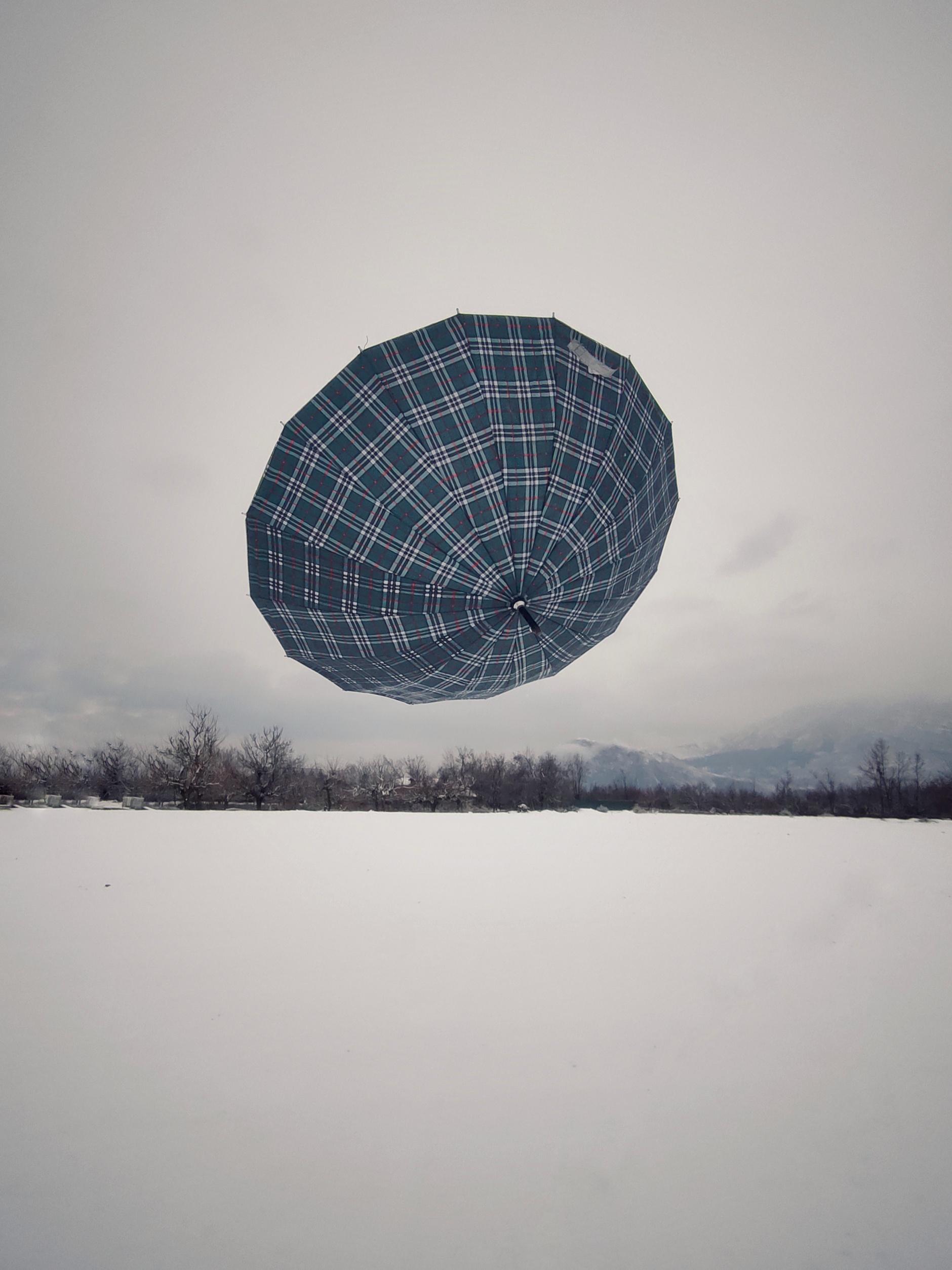 Umbrella in air