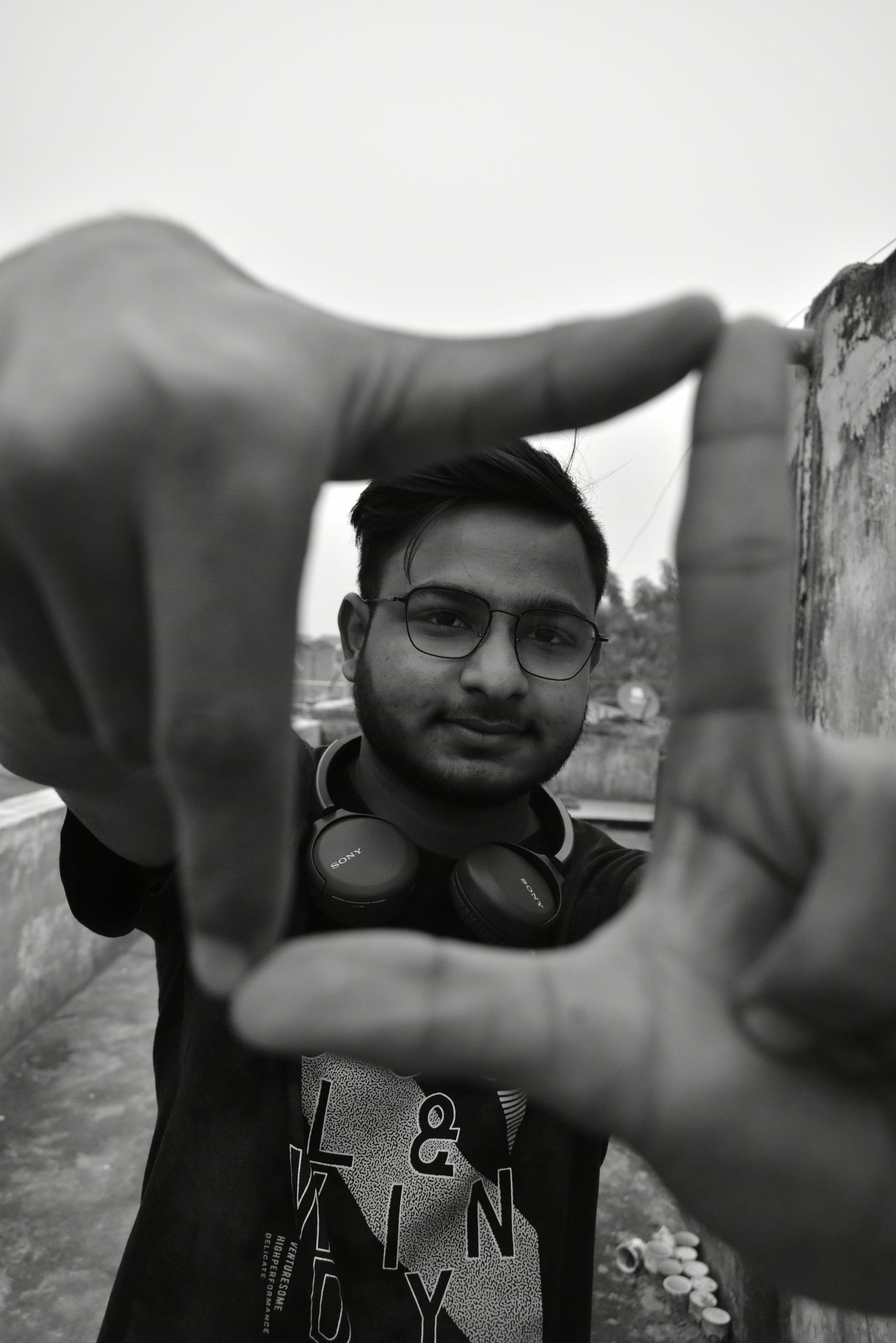 Boy making hand gesture