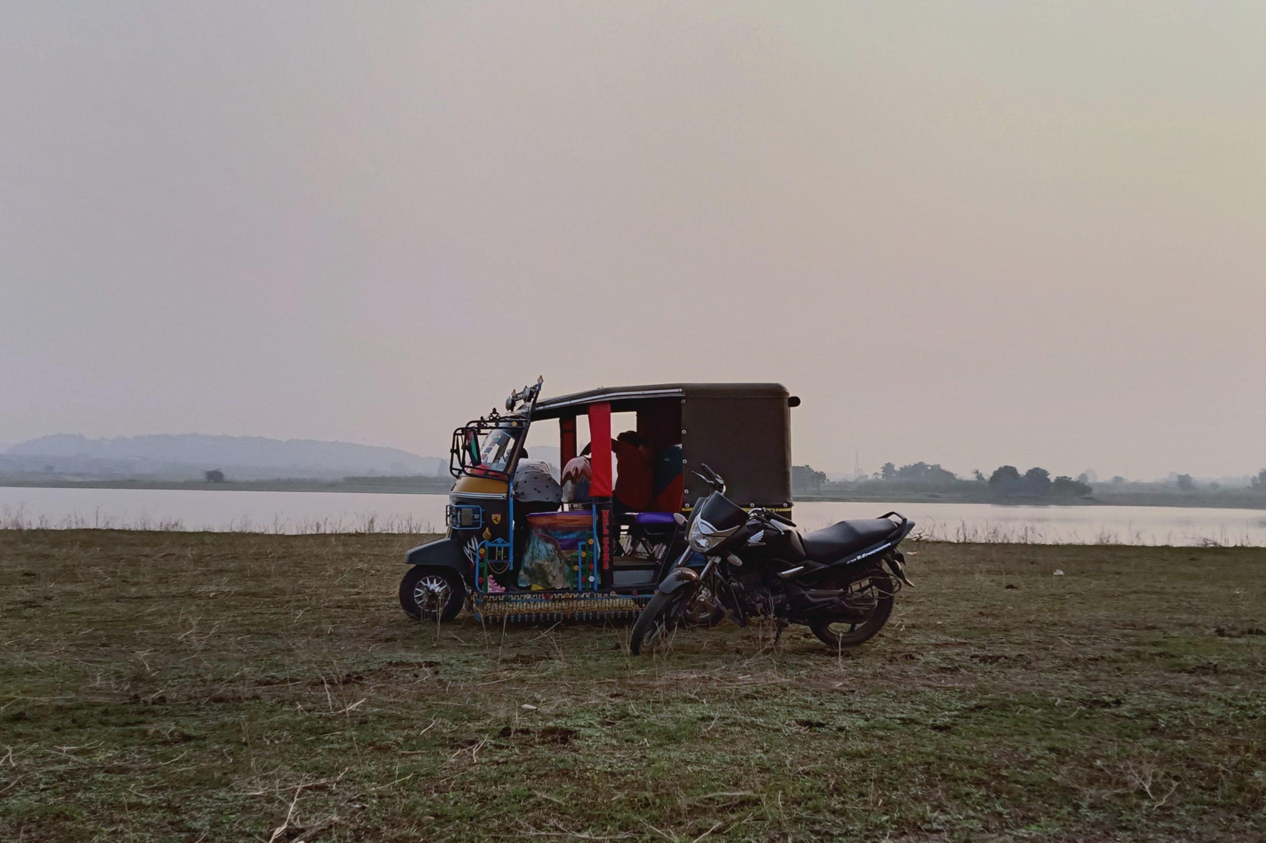 An auto rickshaw and a bike