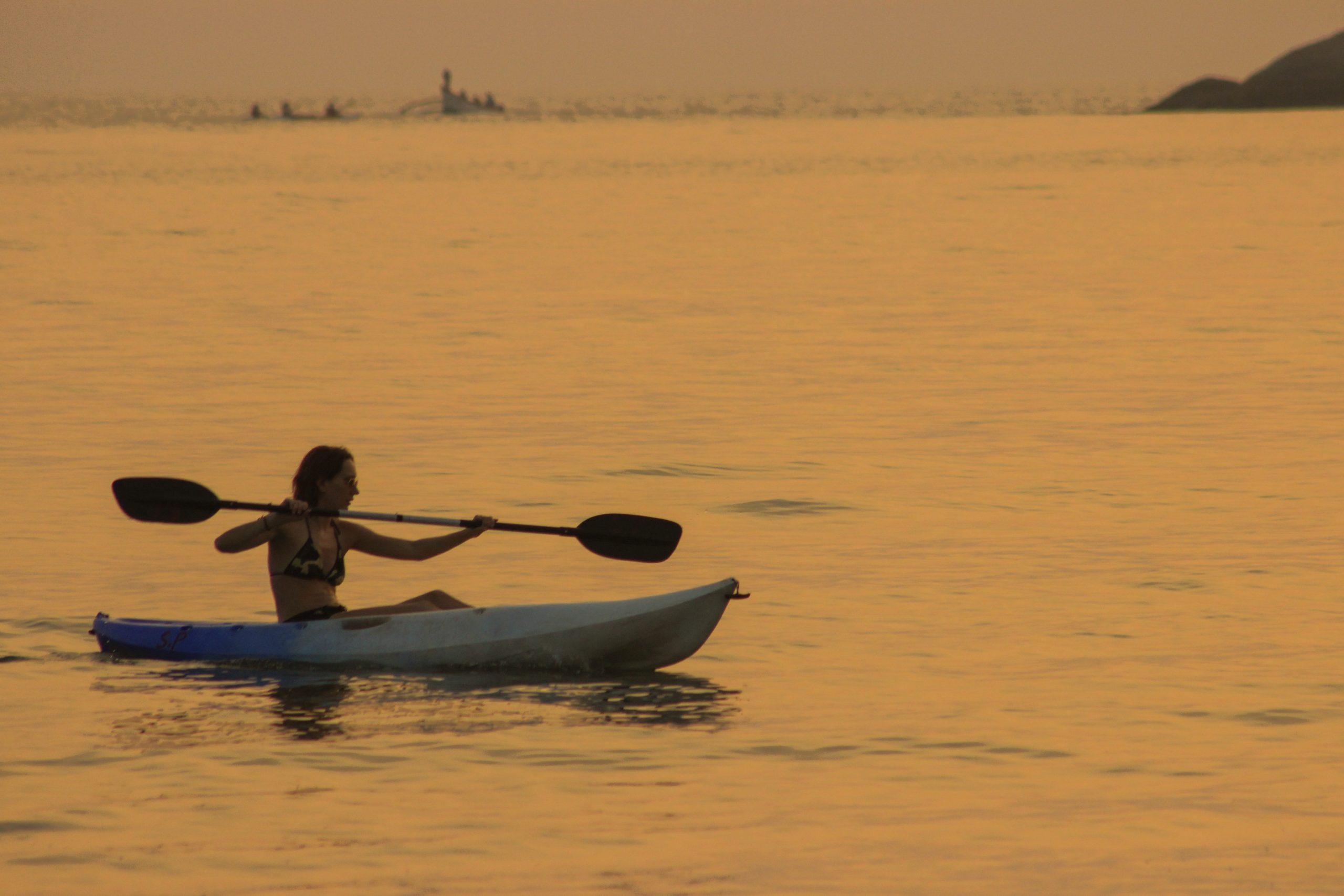 Women in bikini sailing in sea