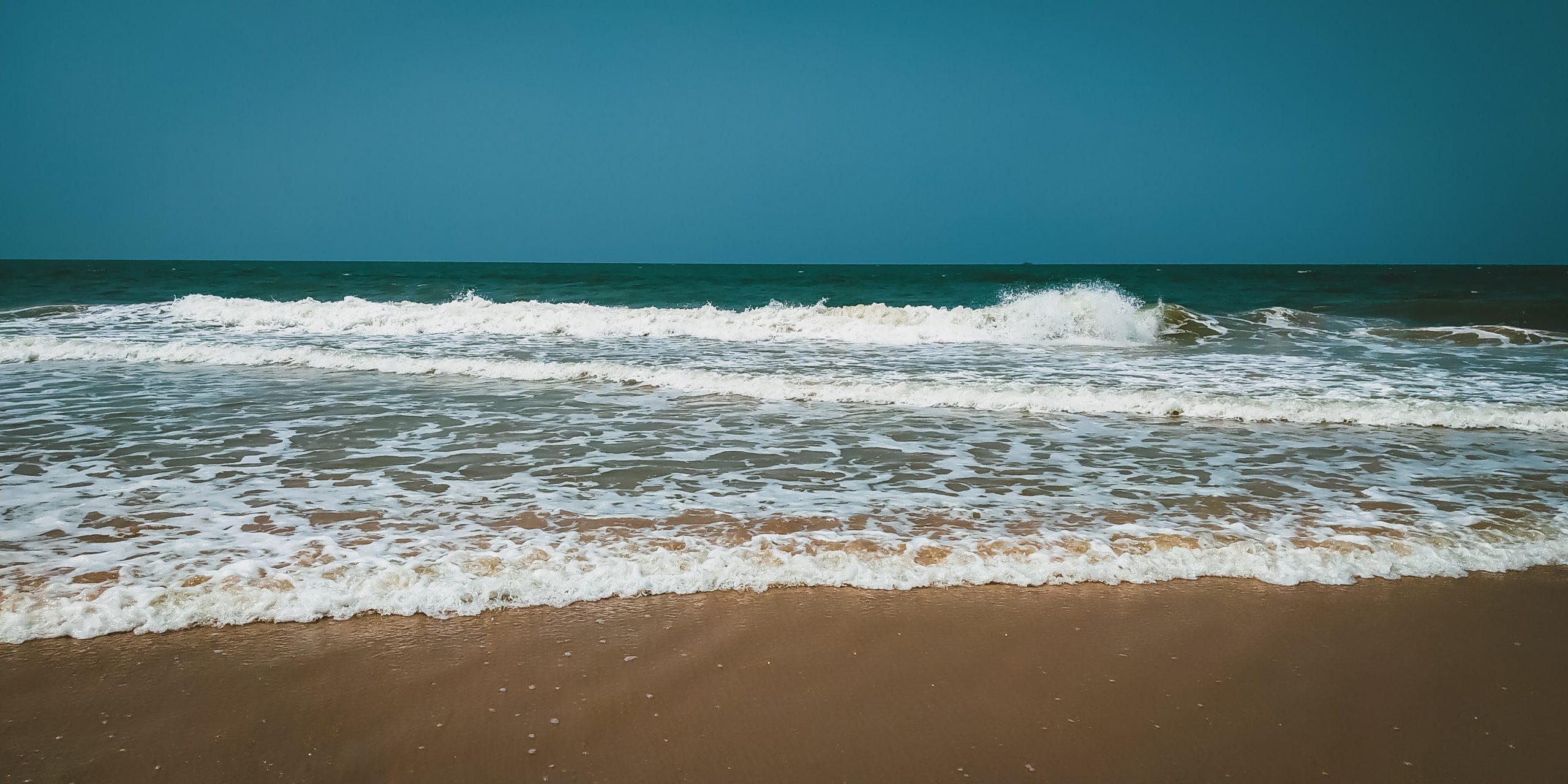 Beautiful scene of a wavy water at beach