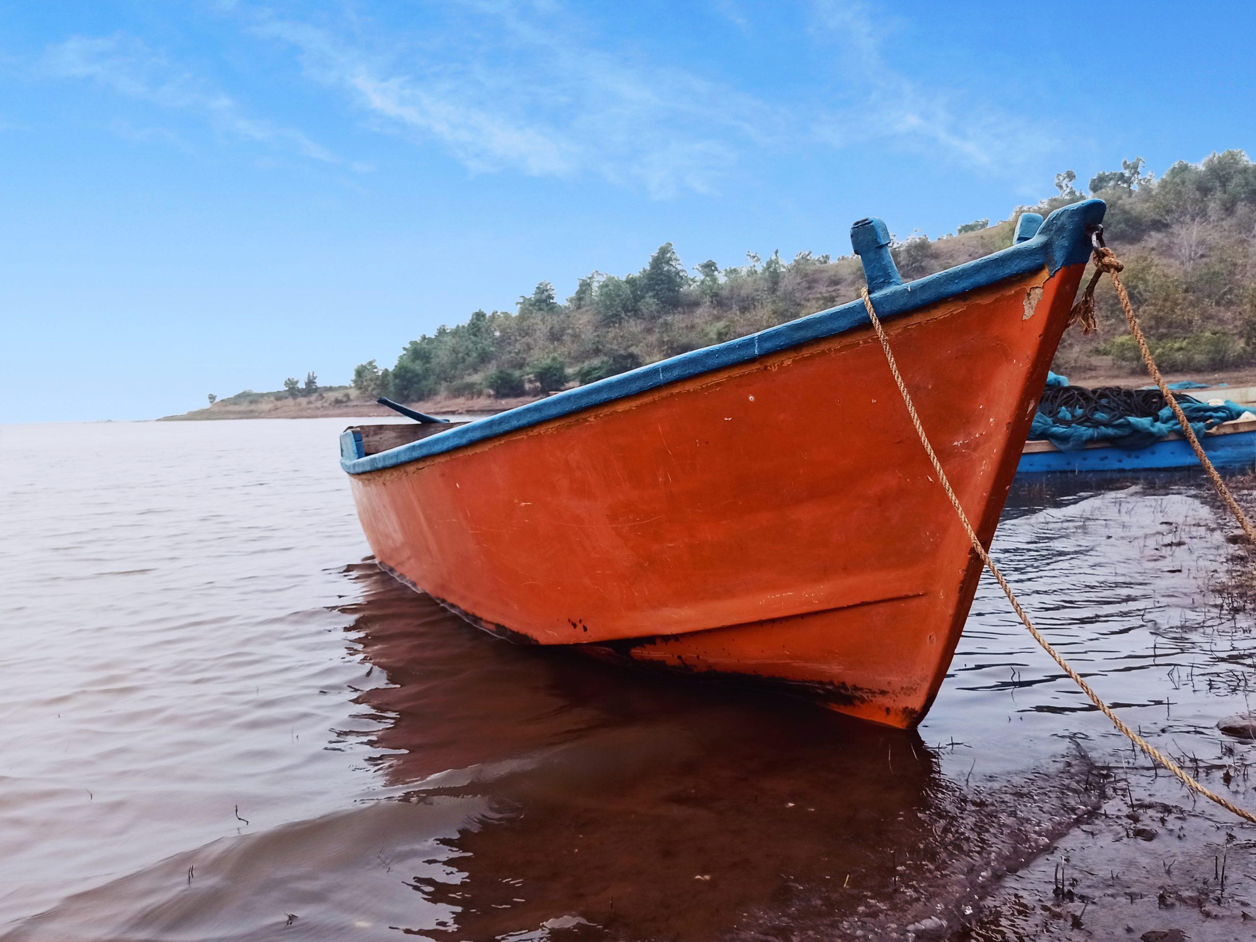 Orange boat in water