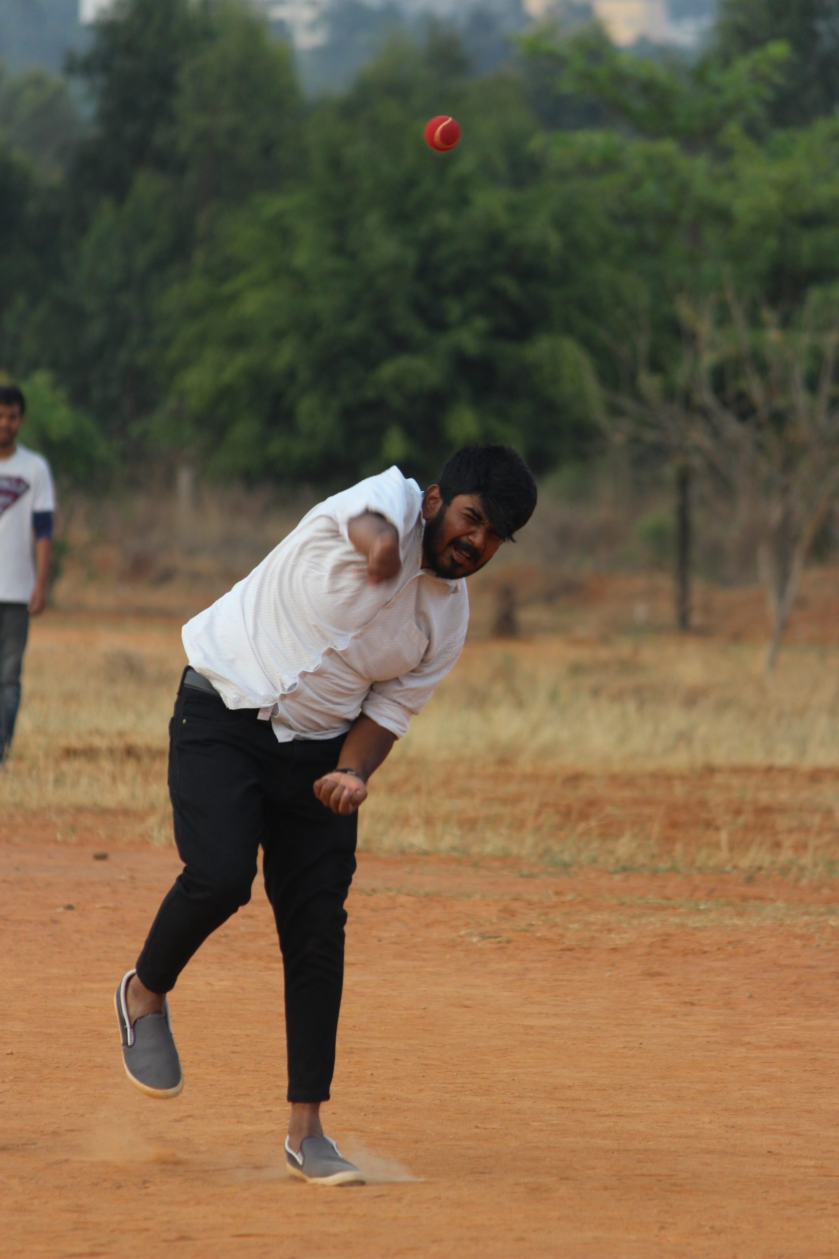 A boy playing cricket