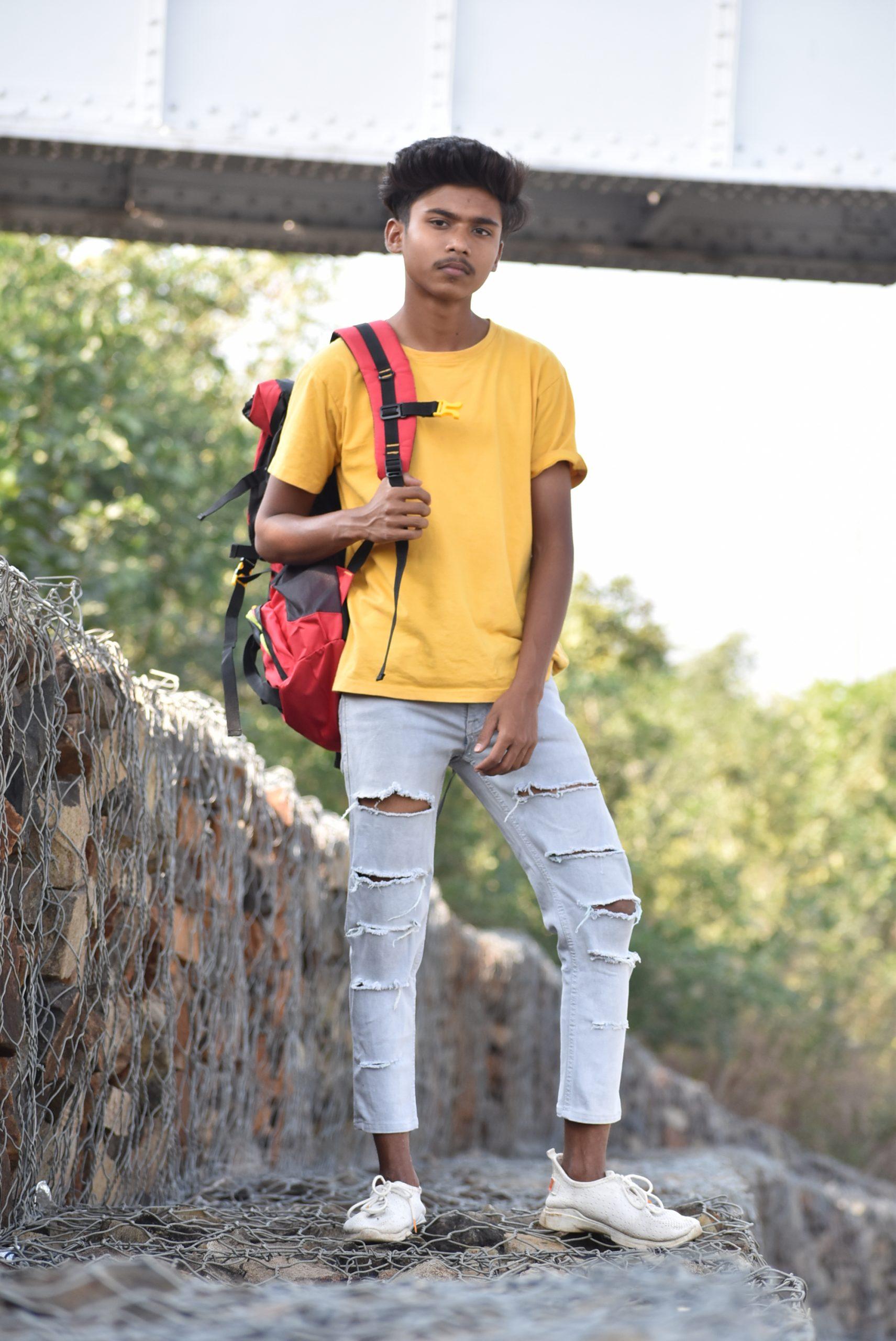 Boy posing with bag